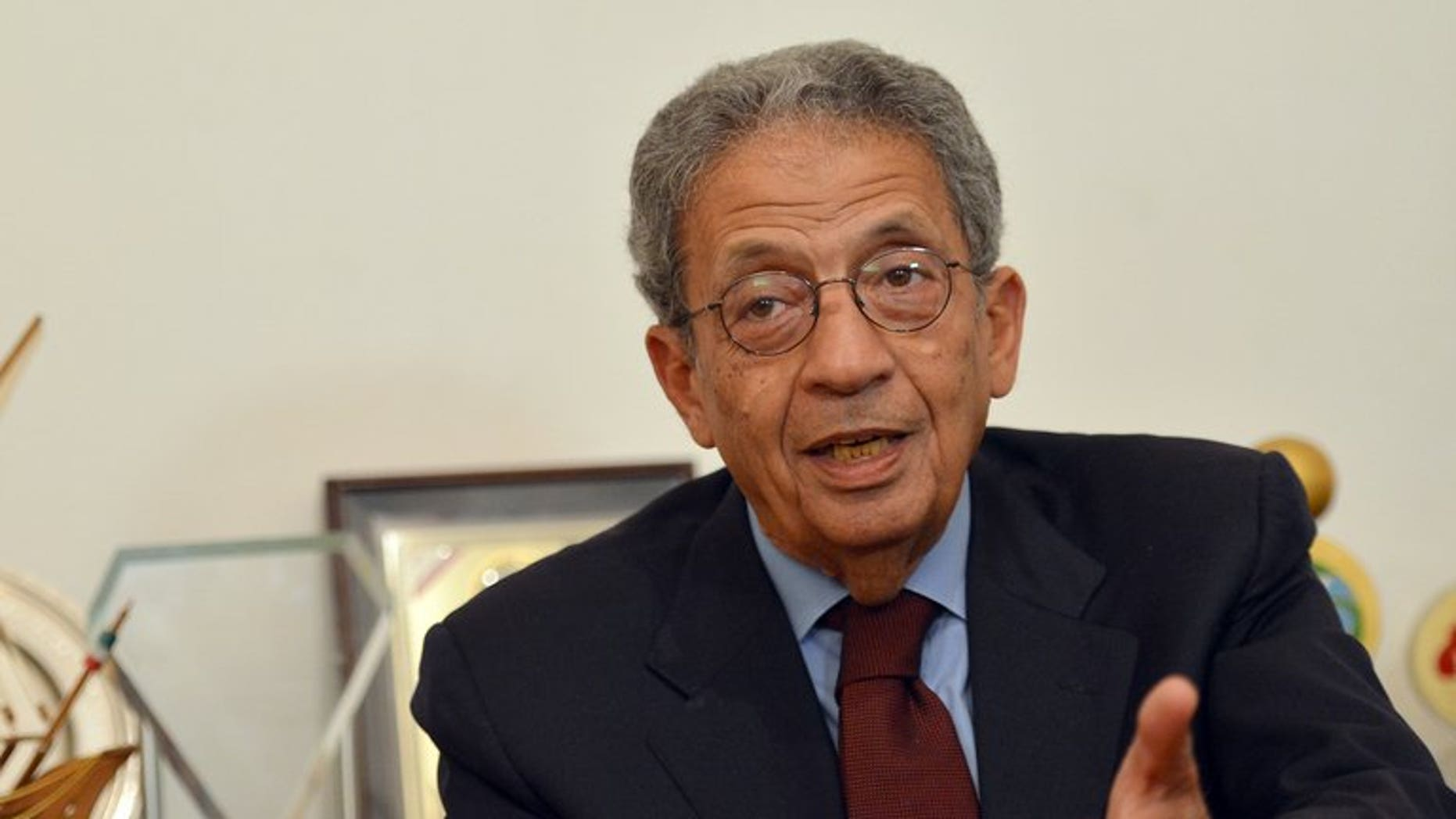 Former Arab League chief Amr Mussa talks during an interview with AFP at his office in Cairo, on March 14, 2013. Mussa has been elected head of Egypt's 50-member panel that has been tasked with drawing up a new constitution.