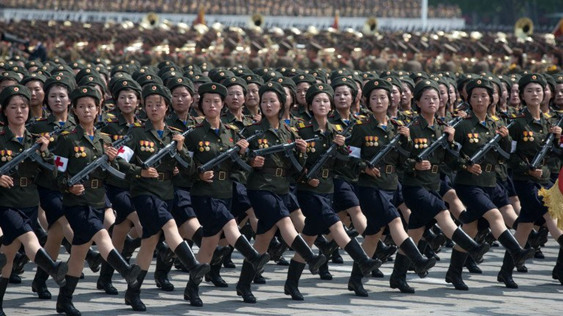 North Korean soldiers march during a military parade in Pyongyang on July 27, 2013. A second mass parade was held Monday.