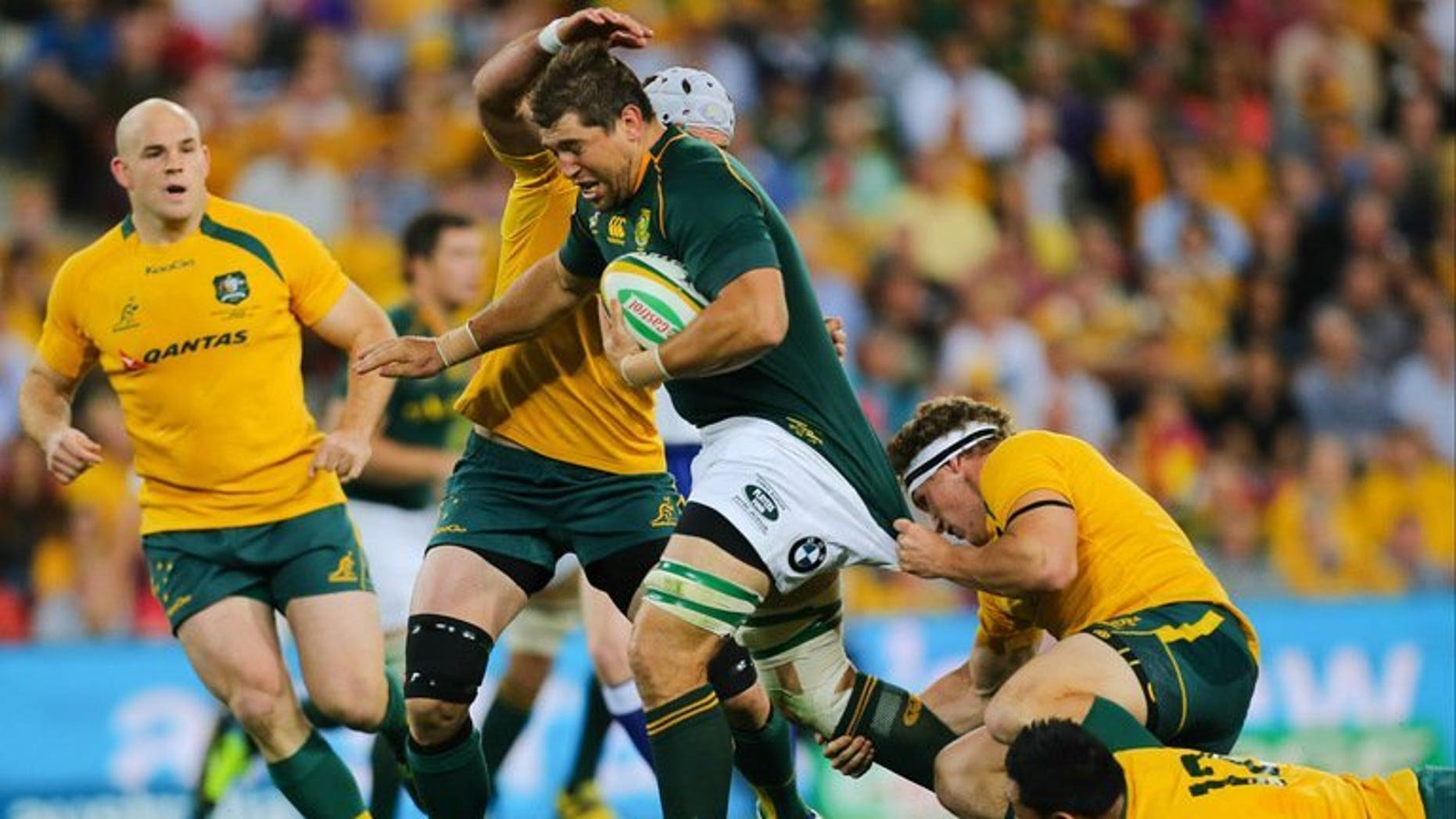 Australia's Michael Hooper and Christian Lealiifano try to tackle South Africia's Willem Alberts during their match on September 7, 2013. Lealiifano said Monday the team remain unified despite three straight losses under new coach Ewen McKenzie.