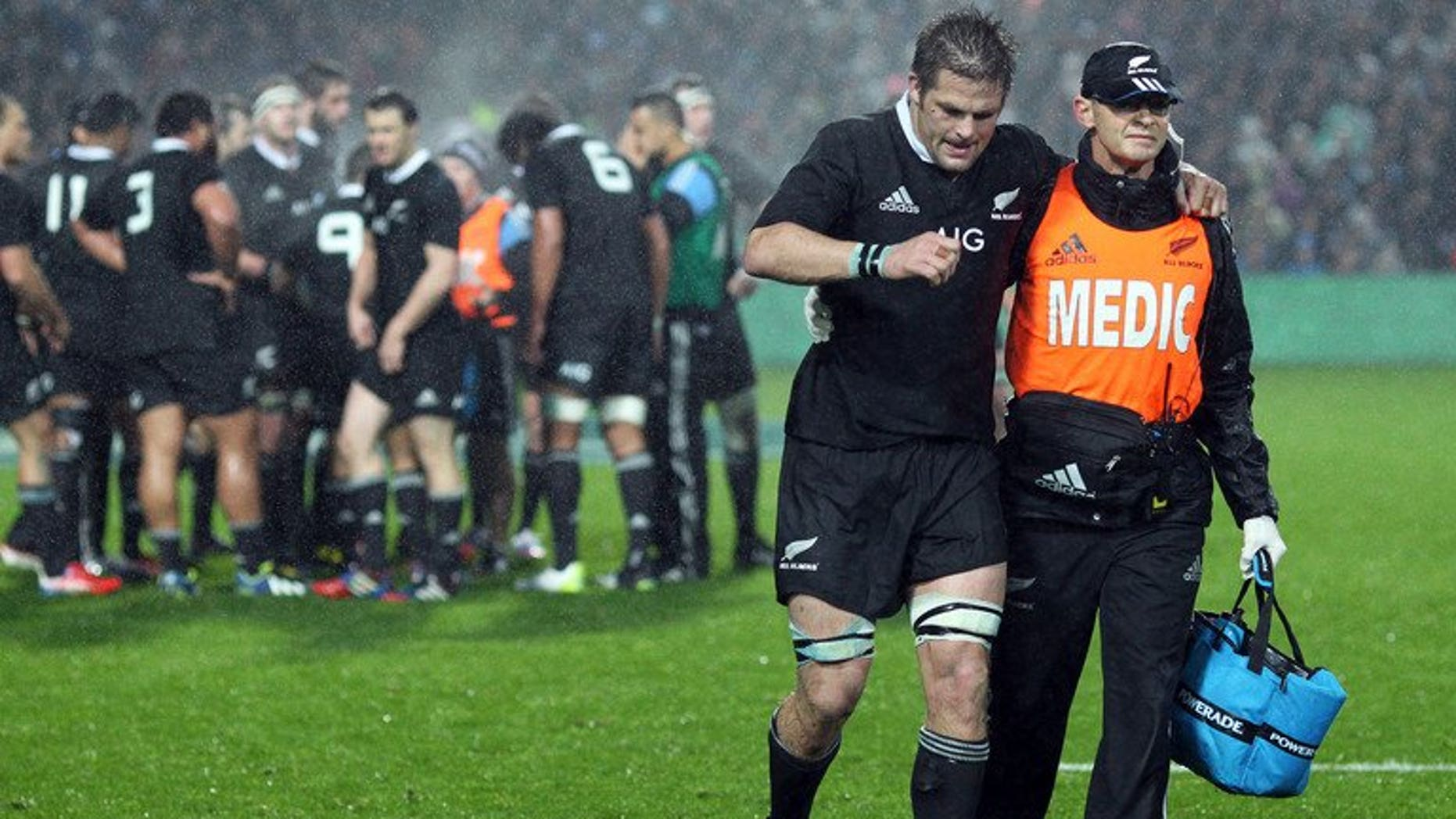 """New Zealand's Richie McCaw is helped off the field during the Rugby Championship match against South Africa on September 7, 2013. The Springboks landed in Auckland Monday for """"the ultimate challenge"""" against the All Blacks next weekend, claiming they remain the underdogs despite New Zealand losing McCaw."""