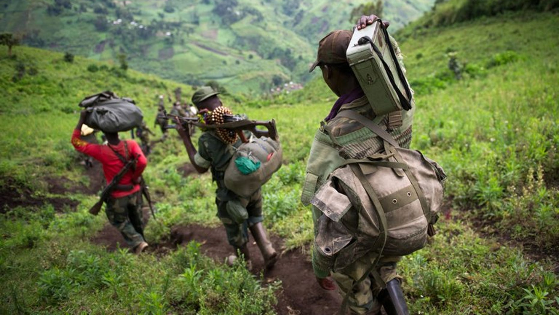 M23 rebels leave the village of Karuba, eastern DR Congo, on November 30, 2012. The rebeles say they are waiting for a government delegation to arrive to resume peace talks, in line with an ultimatum set by regional leaders.