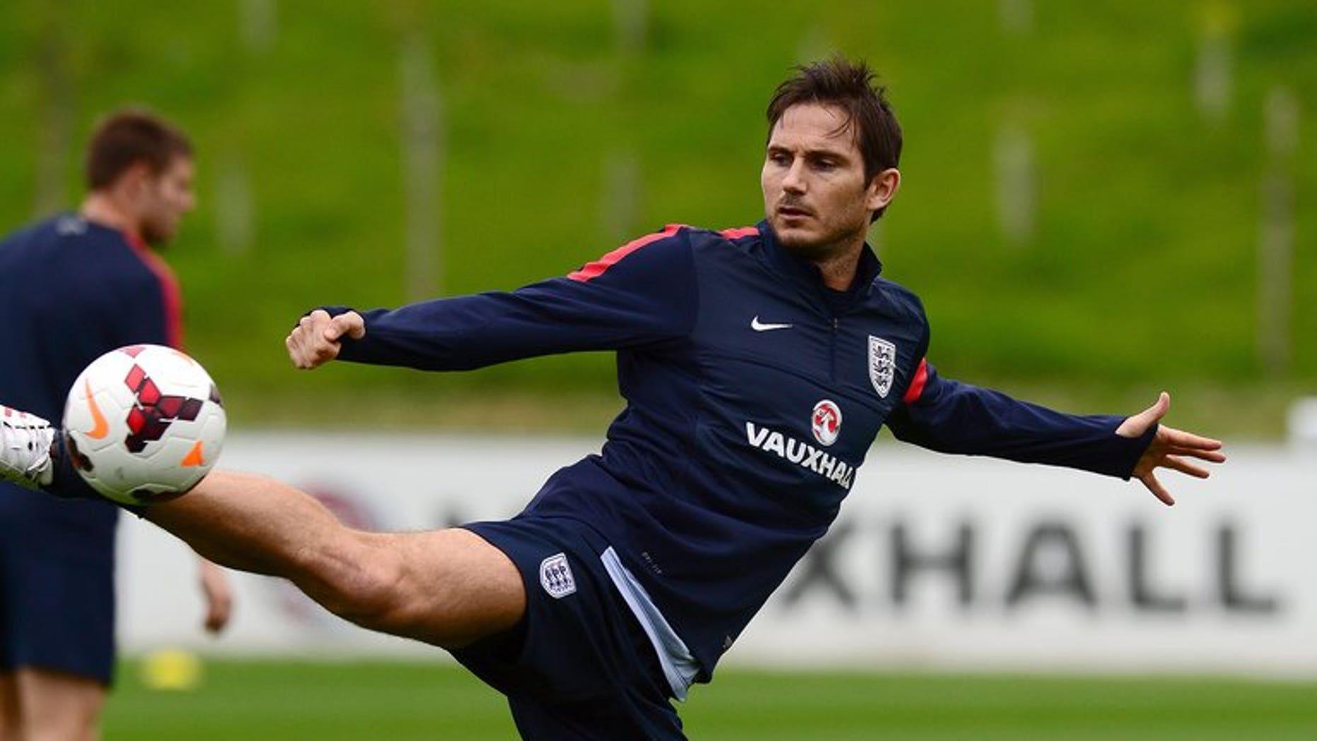 England midfielder Frank Lampard kicks the ball in Burton-on-Trent, central England, on September 3, 2013.
