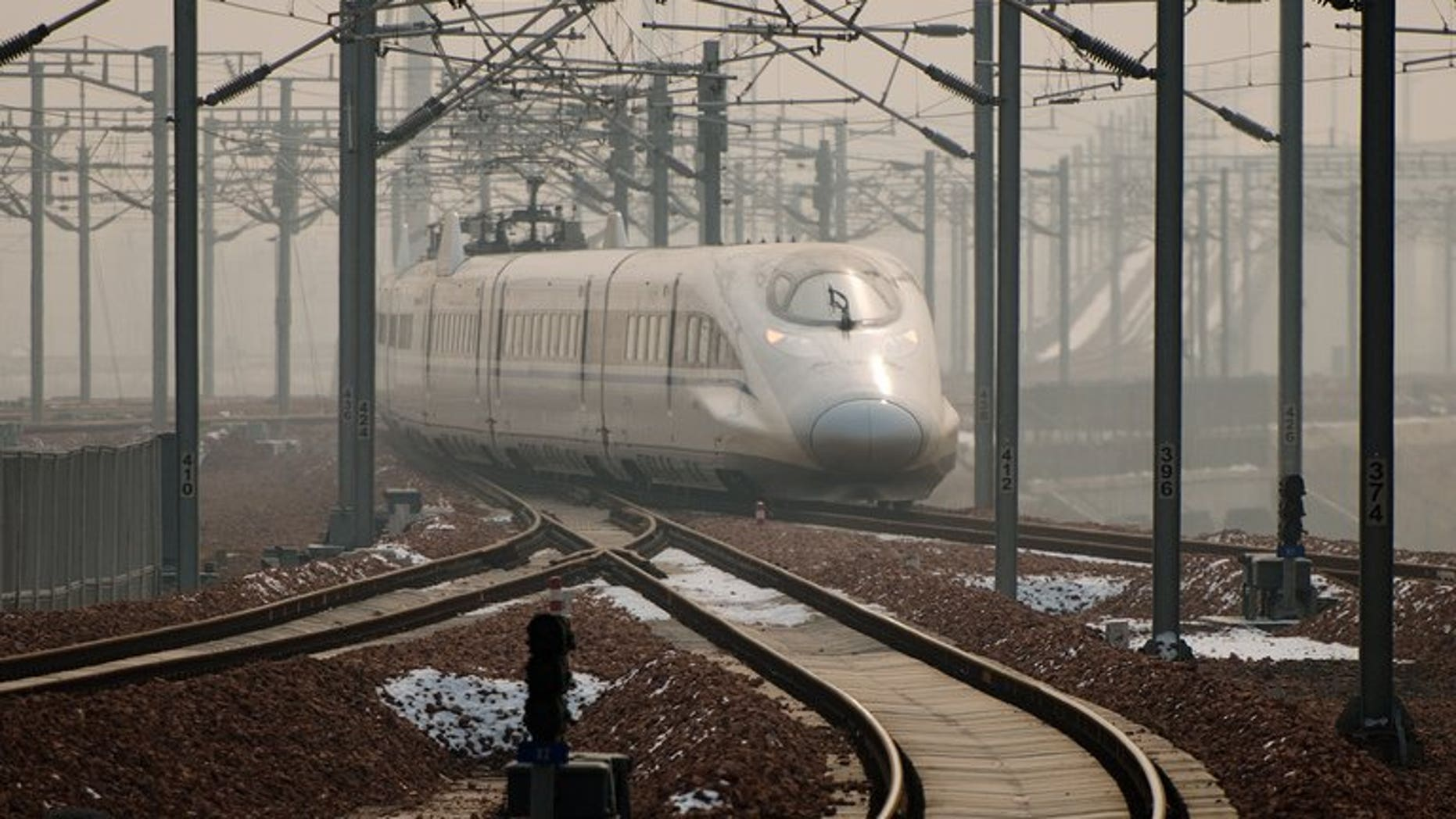 A high-speed train departs a platform in Hebei province south of Beijing on December 22, 2012. Senior official from teh country's disgraced railways ministry, Zhang Shuguang, went on trial Tuesday accused of bribery.