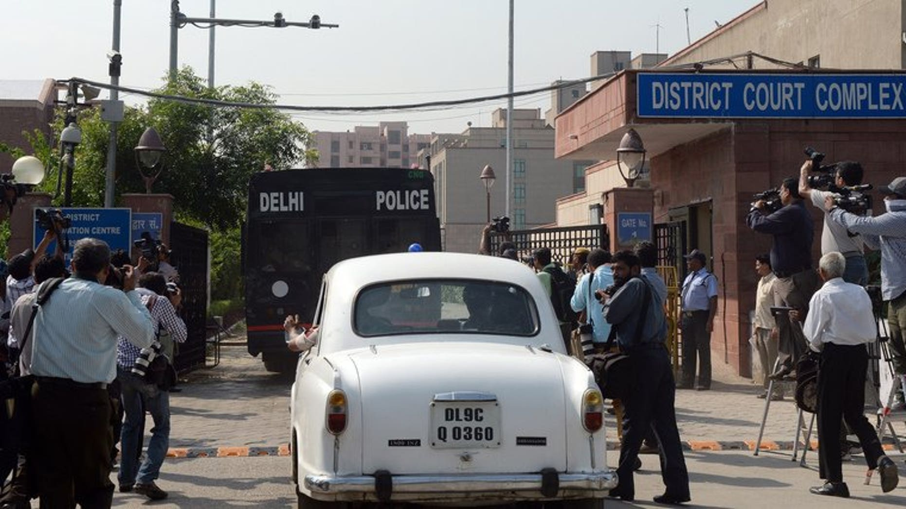A Delhi police van believed to be carrying the accused in a gang rape case enters the court complex on September 10, 2013. All four defendants were found guilty of the gang rape and murder of a student on a New Delhi bus.