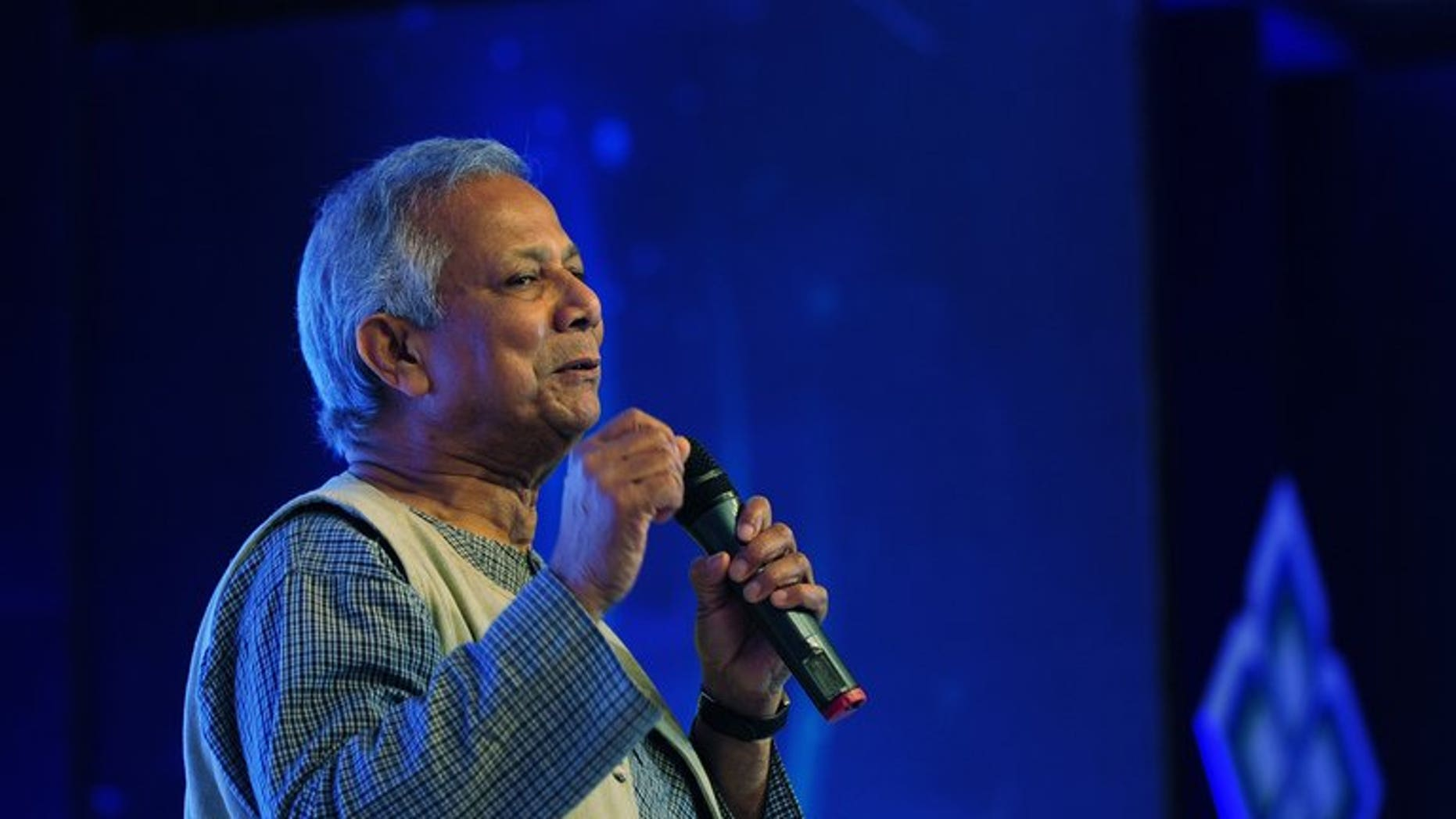 """Nobel laureate Muhammad Yunus speaks during the Social Business Day in Dhaka on June 28, 2013. Bangladesh's cabinet has ordered """"legal action"""" against 2006 Nobel Peace Prize winner Muhammad Yunus, accusing him of avoiding taxes on income from awards, book royalties and foreign tours."""