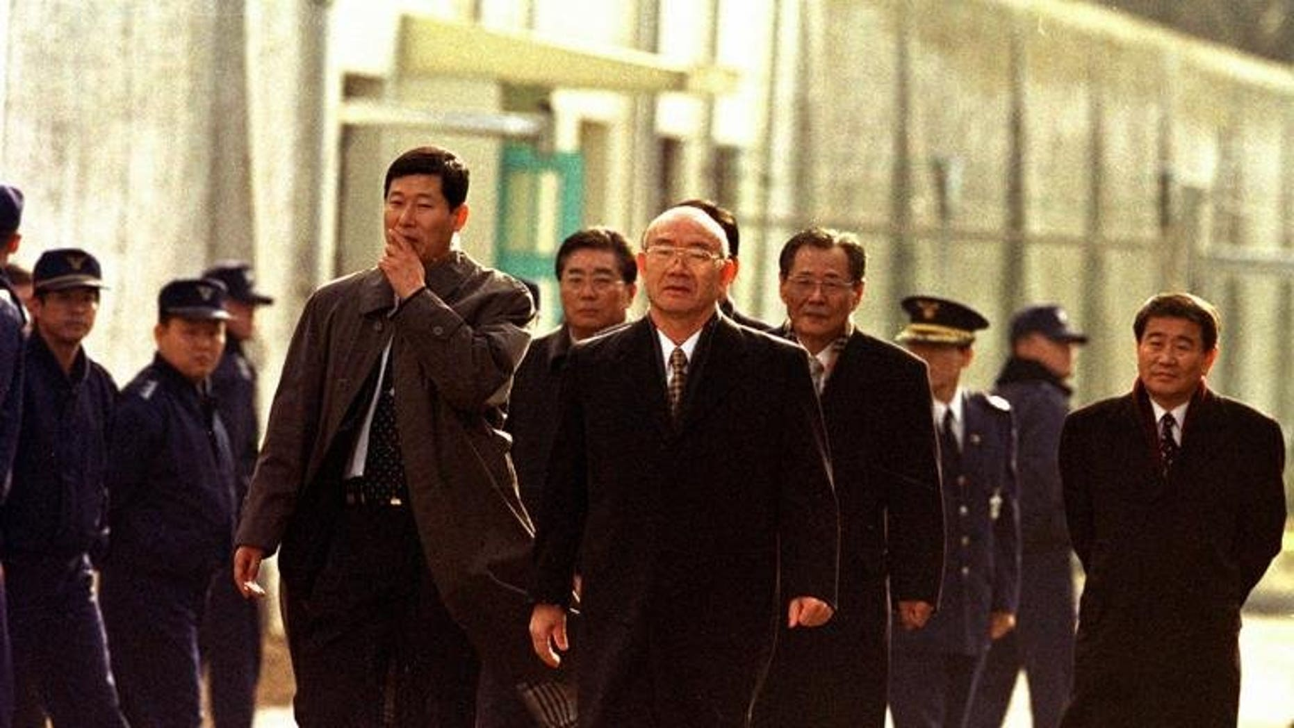 Former South Korean president Chun Doo-Hwan, 65, walks to freedom in 1997 after two years in Anyang Prison for corruption, mutiny and treason. The family of former South Korean dictator Chun Doo-Hwan promised Tuesday to pay millions of dollars in remaining fines imposed for bribes the disgraced military strongman took while in office.