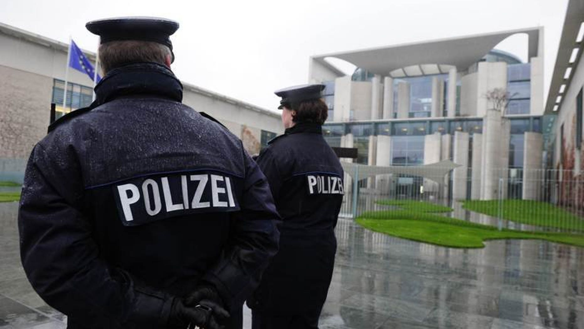 German police officers patrol in front of the Chancellery in Berlin on November 18, 2010. German police have arrested a man over an alleged far-right plot to use explosives mounted on a model airplane against political opponents, authorities said Tuesday.
