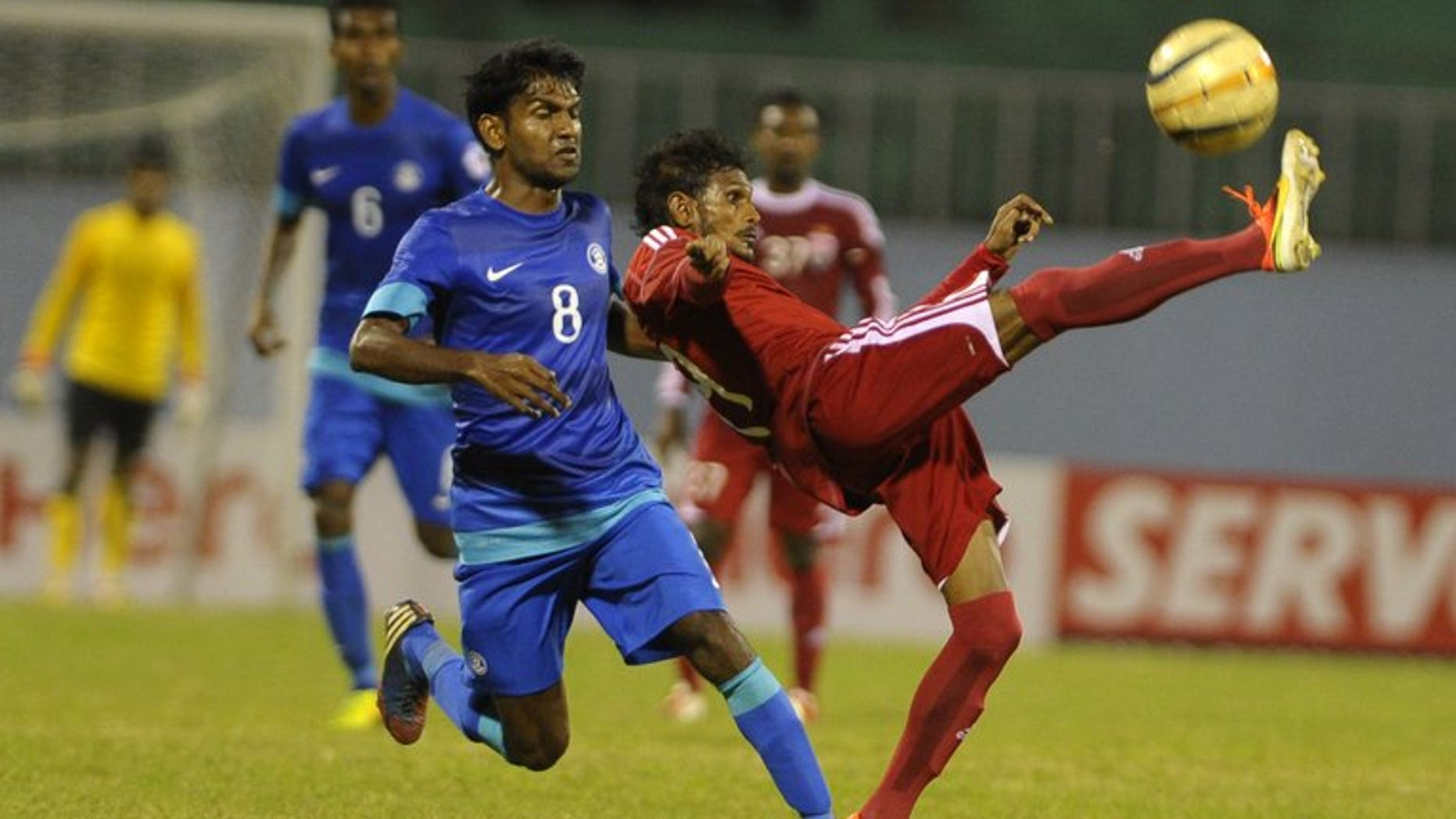 India's Francisco Fernandens (left) vies with Maldives' Akram abul Gani (right) during their SAFF Championships semi-final football match in Kathmandu on September 9, 2013. India won 1-0. The Maldives' football coach has blamed a disputed penalty decision for flared tempers after his team's 1-0 loss to India which saw a player assault the referee and the police called in to restore calm.