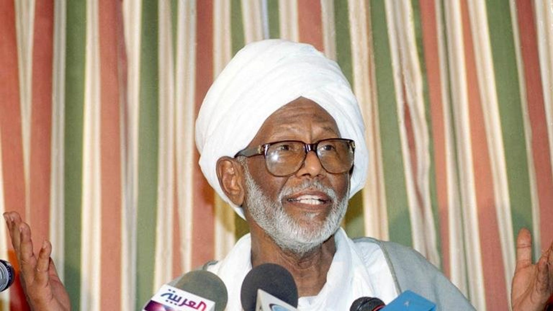 Sudan's Popular Congress Party (PCP) leader Hassan al-Turabi speaks during a press conference in Khartoum, on October 14, 2003. The PCP say that Yousef Mohammed Saleh Lebis -- who was jailed in connection with an alleged coup attempt in 2004 -- has been released by Sudanese authorities.
