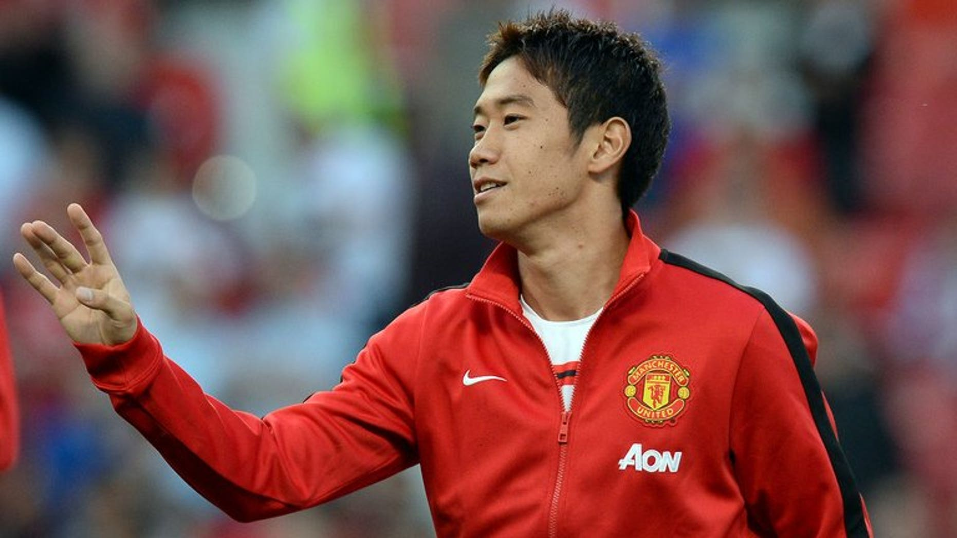 Shinji Kagawa warms up ahead of Manchester United's game against Chelsea at Old Trafford on August 26. Kagawa voiced frustration at being sidelined by new Manchester United manager David Moyes after scoring a cracker in his country's 3-1 win over Ghana on Tuesday.