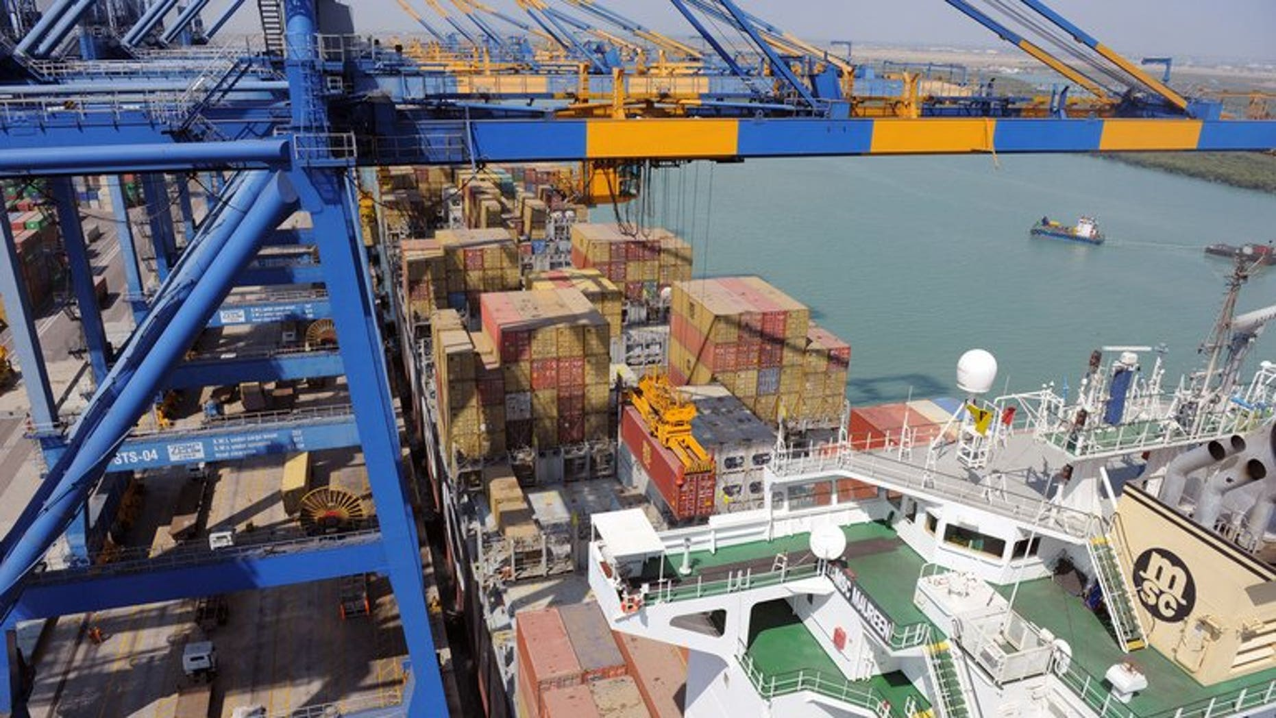 A container ship is unloaded at the Mundra Port and Special Economic Zone at Mundra on February 17, 2011.