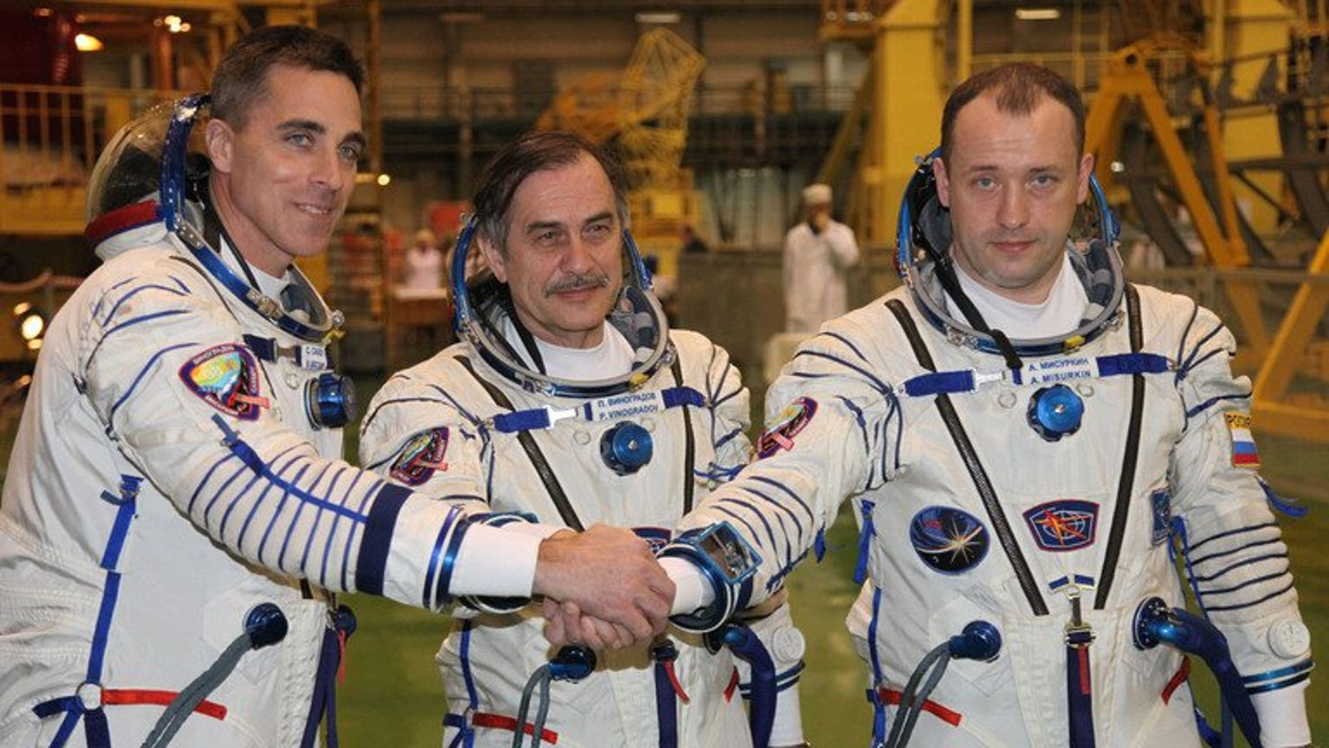 Russian cosmonauts, Pavel Vinogradov (C), Alexander Misurkin (R), and US astronaut Christopher Cassidy during training at Kazakhstan's Baikonur cosmodrome on March 17, 2013. The three returned to Earth Wednesday on board a Russian Soyuz capsule after a half-year mission on the International Space Station (ISS), landing in Kazakhstan, mission control in Moscow announced.