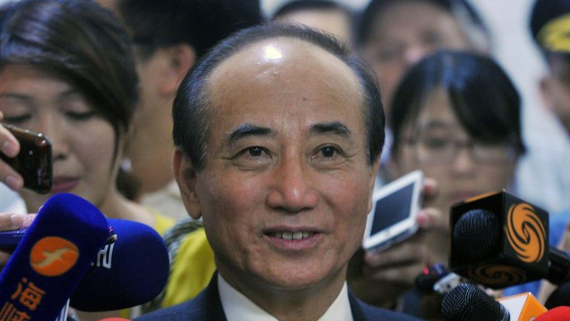 Taiwan's Legislative Speaker Wang Jin-pyng (C) speaks at parliament in Taipei on September 11, 2013.