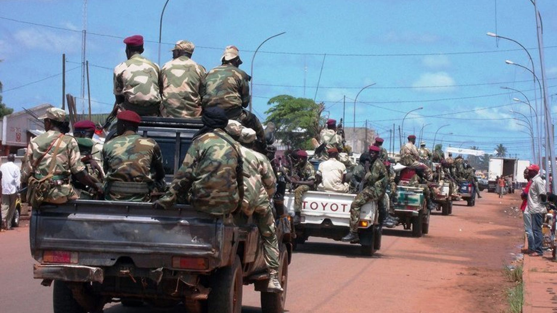 Troops in charge of disarmament ride through the Central African Republic capital Bangui on September 5, 2013. Almost 100 people have died this week in two days of fighting between the new Central African Republic president's forces and those loyal to ousted leader Francois Bozize, the presidency said Wednesday, updating an earlier toll.