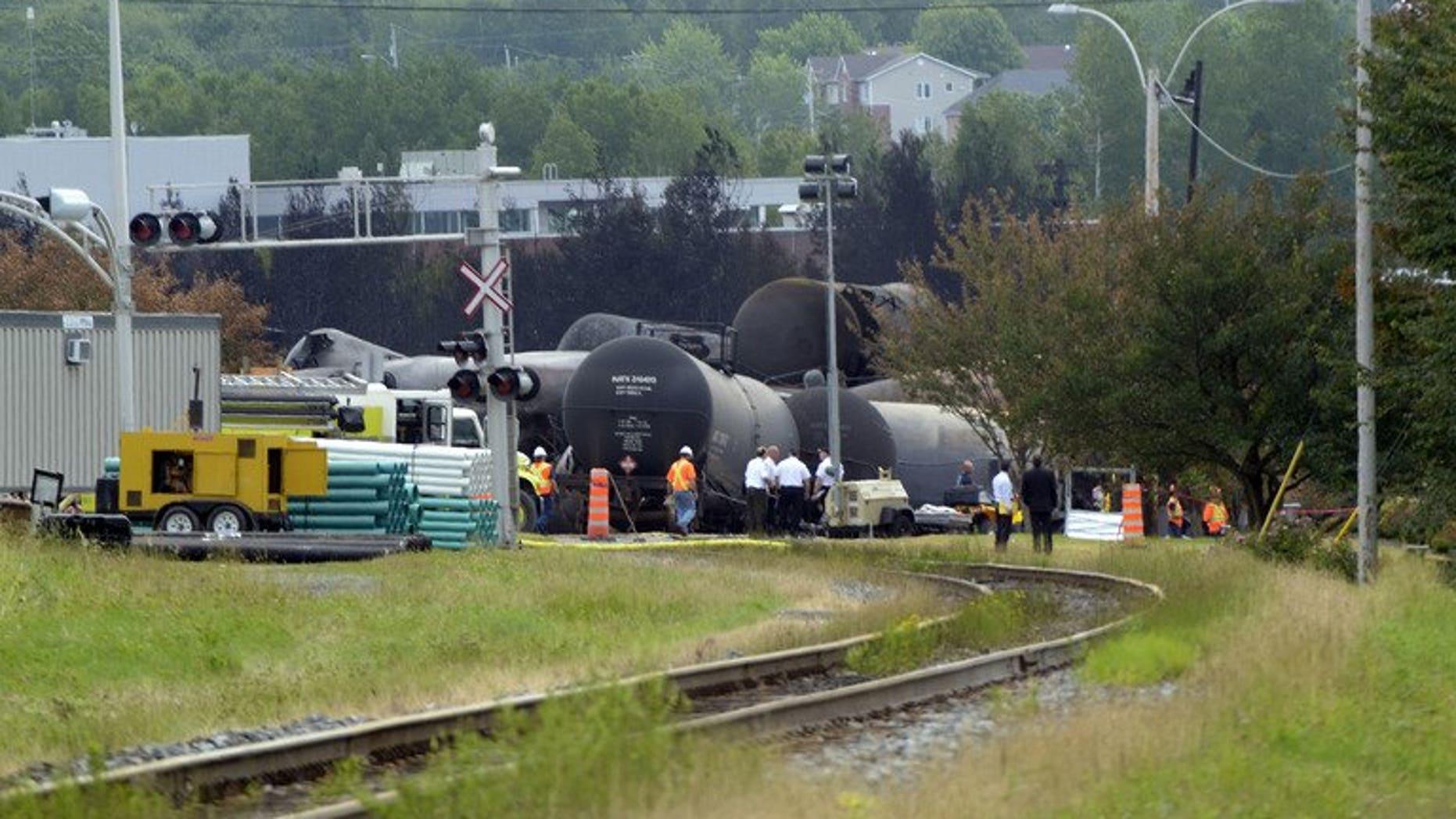 Investigators work at a train derailment site July 9, 2013 in Lac-megantic, Quebec, Canada.