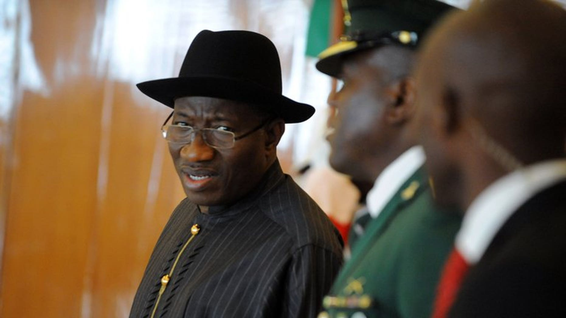 Nigerian President Goodluck Jonathan (L) in Abuja on July 18, 2013.