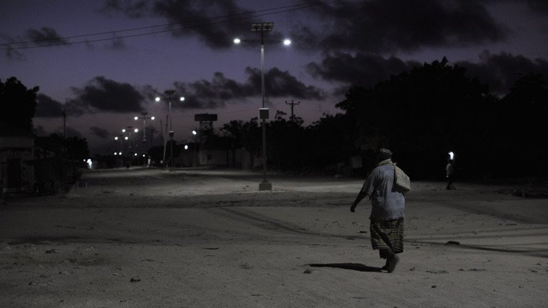 """A man returns home from the mosque in central Mogadishu, on May 21, 2013. Somalia's Al Qaeda-linked Shebab insurgents on Wednesday celebrated the anniversary of the September 11, 2001 attacks with a Twitter eulogy for the """"courageous"""" hijackers."""