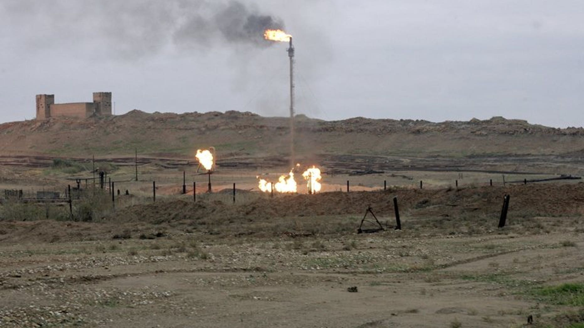 Flares burn at the Northern Kirkuk Oil in northern Iraq on January 6, 2010.