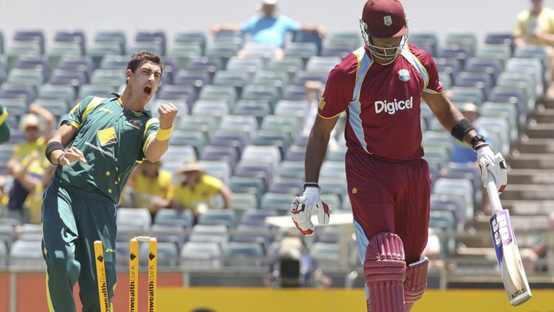 Australia's Mitchell Starc (L) celebrates during an ODI against the West Indies at the WACA ground on February 1, 2013. Perth's WACA ground will be without a Test match when India tour Australia during the 2014-15 season, Cricket Australia has announced.
