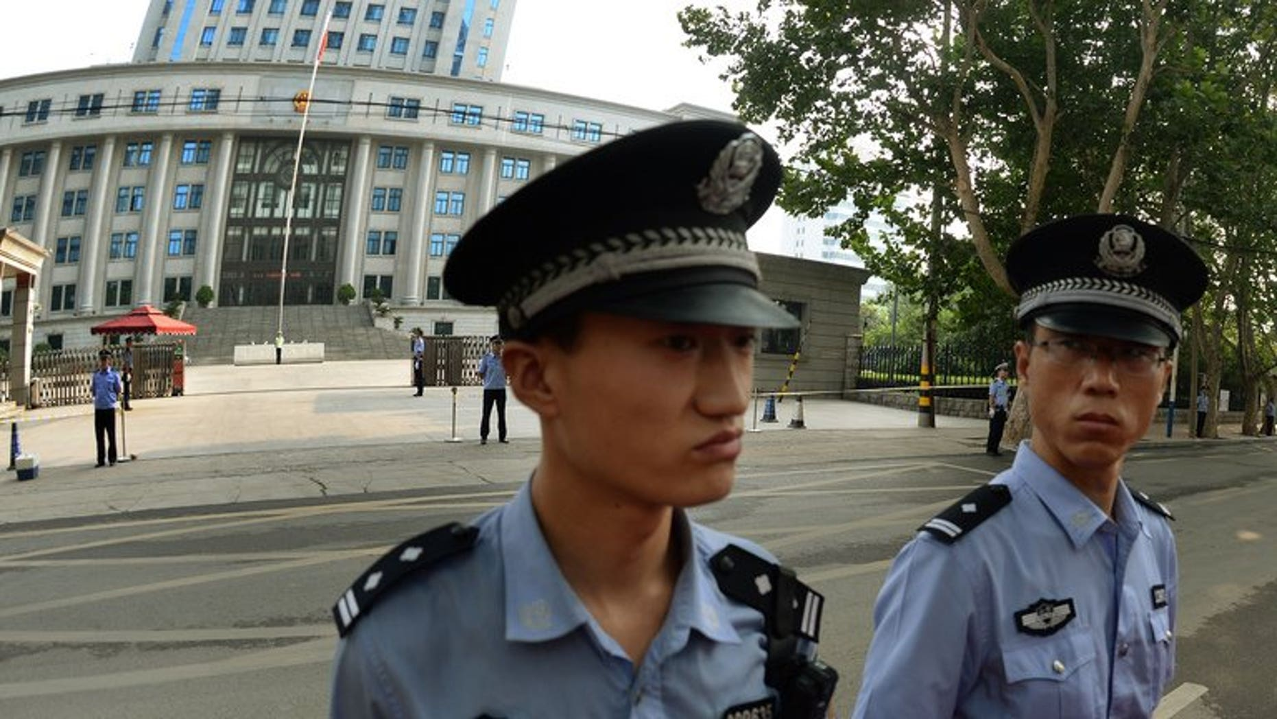 Illustration: Police outside a court in Beijing, where disgraced politician Bo Xilai was tried for graft