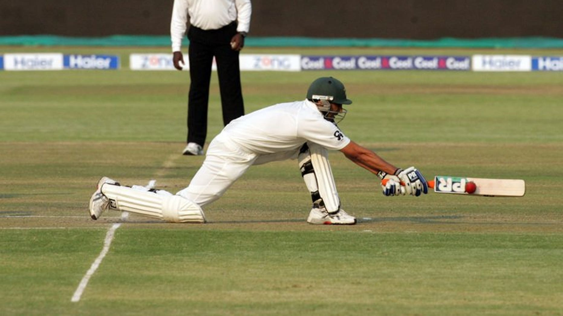 Pakistan batsman Younis Khan executes a reverse sweep shot during the second day of the second test match between Pakistan and hosts Zimbabwe at the Harare Sports Club on September 11, 2013. Pakistan were 211 for five at lunch, still 83 runs behind Zimbabwe's first innings total of 294, with Younis unbeaten on 76.