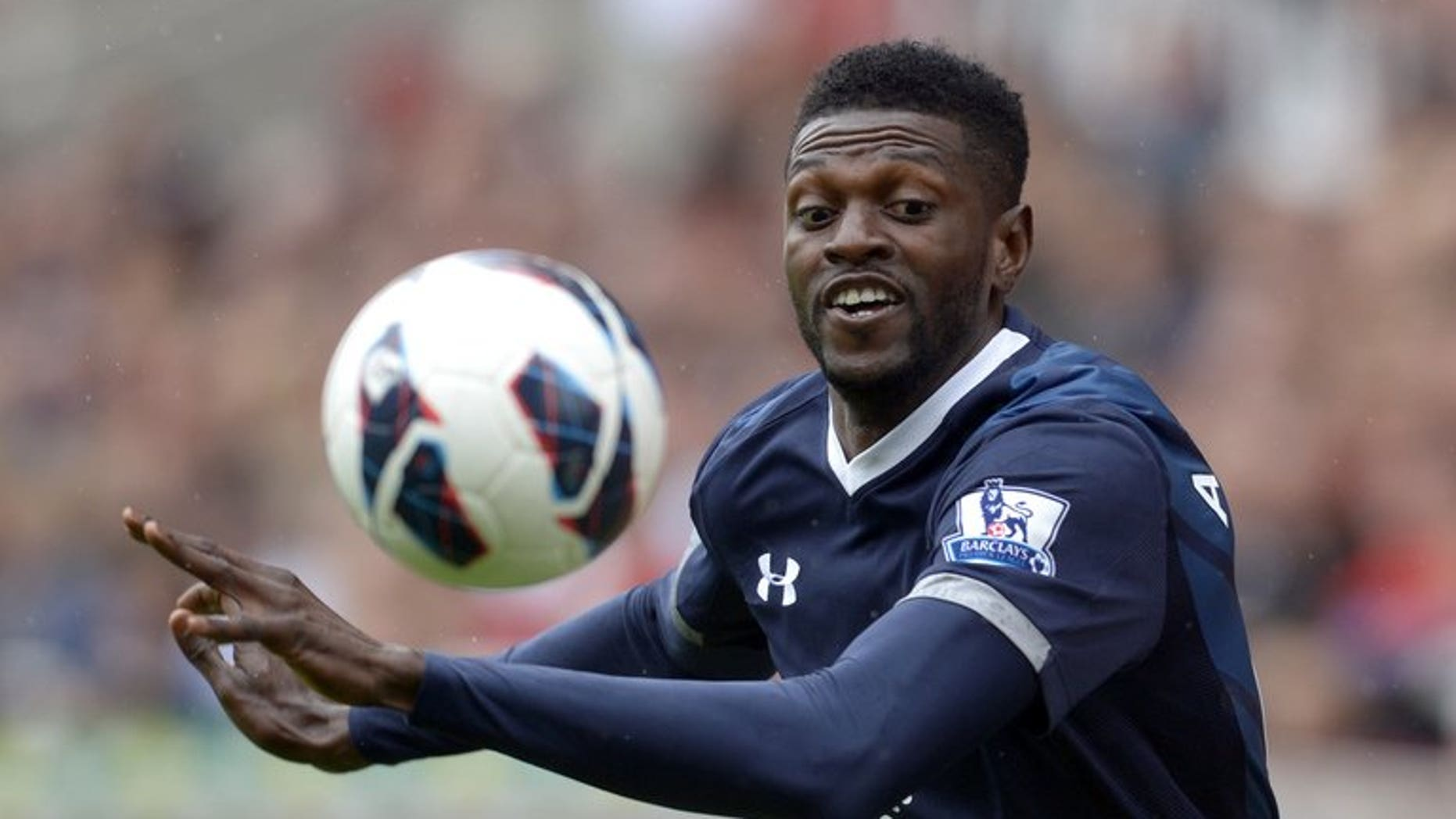 Tottenham Hotspur's Togolese striker Emmanuel Adebayor eyes the ball during the Premier League match against Stoke City in Stoke on Trent, central England, on May 12, 2013. Tottenham Hotspur manager Andre Villas-Boas revealed on Thursday that he has asked Togolese striker Emmanuel Adebayor to train with the Premier League club's reserve team.