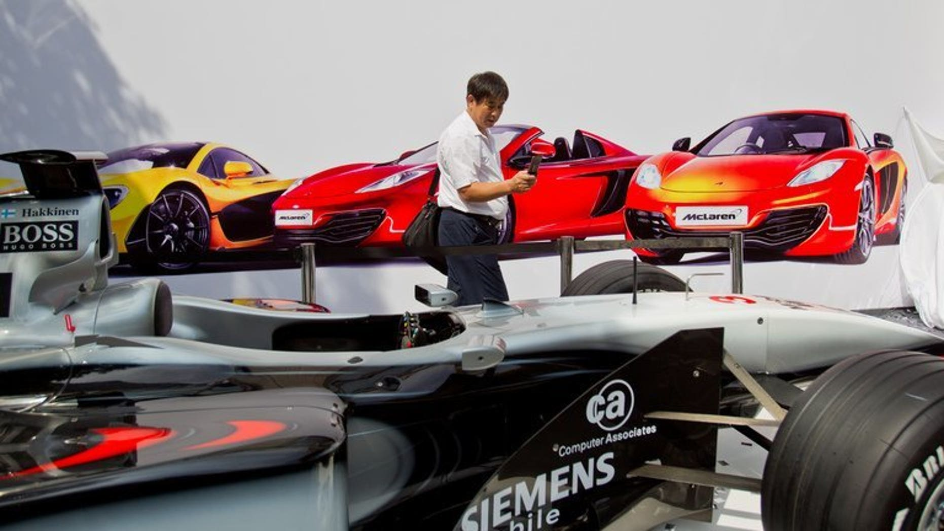 Mclaren Automotive's first Chinese dealership opens in Shanghai on Thursday. Britain's McLaren opened its first car dealership in mainland China, hoping to sell the country's wealthy elite its Formula One-inspired vehicles for up to $2.1 million apiece.