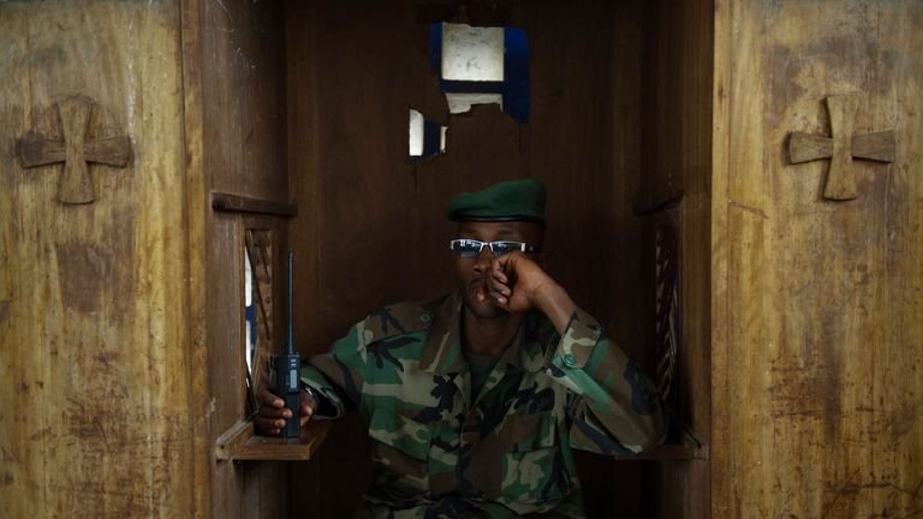 An M23 soldier sits in a confession booth in a church during a session to teach the rebel movement's values in Rumangabo in the east of the Democratic Republic of Congo, on July 20, 2013. Mediators in peace talks between Democratic Republic of Congo's government and M23 rebels admitted Friday the sides were yet to negotiate face-to-face, but insisted that progress was still being made.