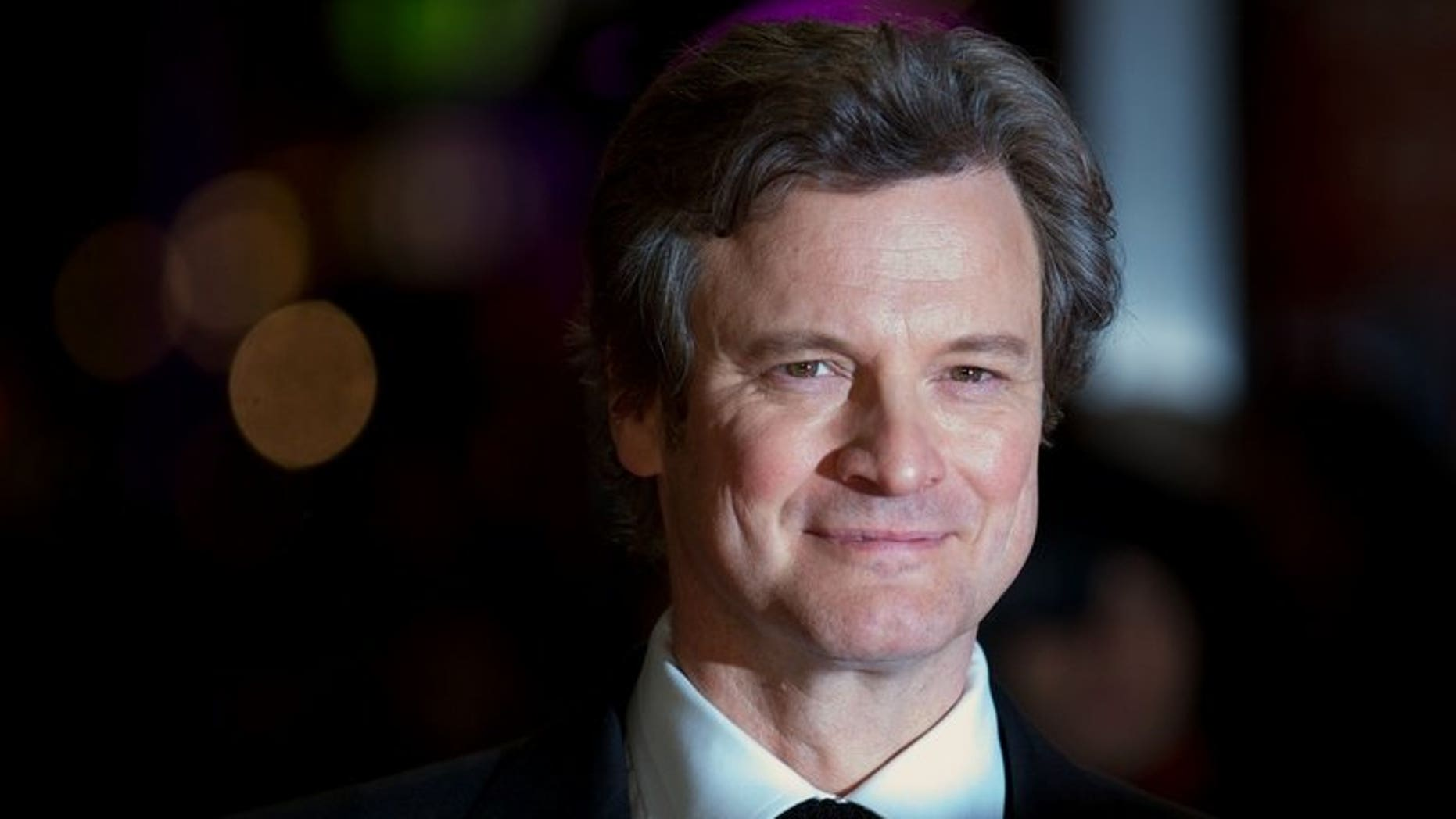 British actor Colin Firth poses on the red carpet as he arrives to attend the premiere of 'Gambit' in Leicester Square, London, on November 7, 2012. The King's Speech star Colin Firth is to voice Paddington Bear in a Hollywood film about the adventures of the duffle-coat-wearing Peruvian, media reports said on Friday.