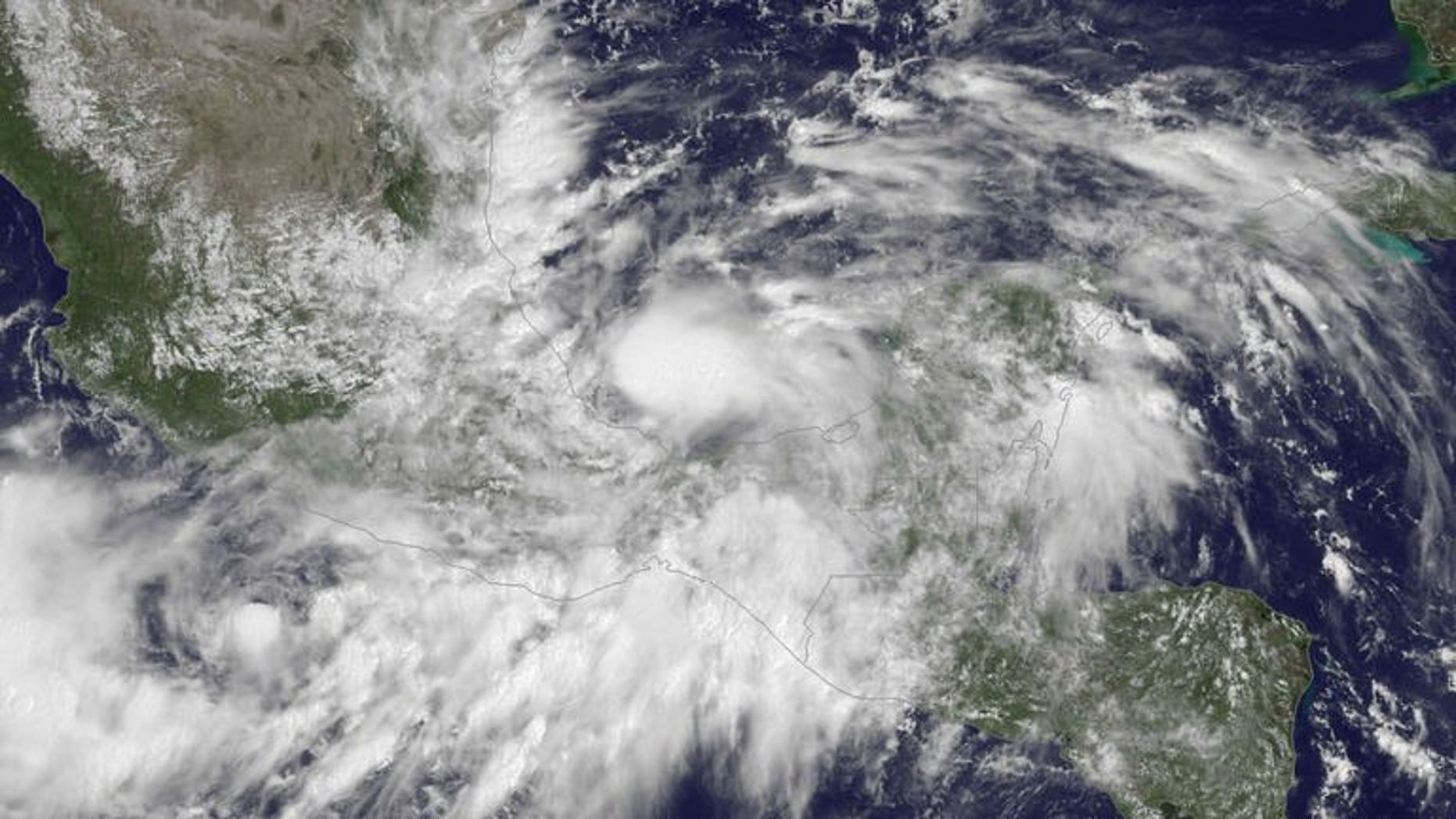 Tropical Storm Ingrid, shown in a NOAA GOES East satellite image released on September 13, 2013, formed off Mexico's eastern coast.