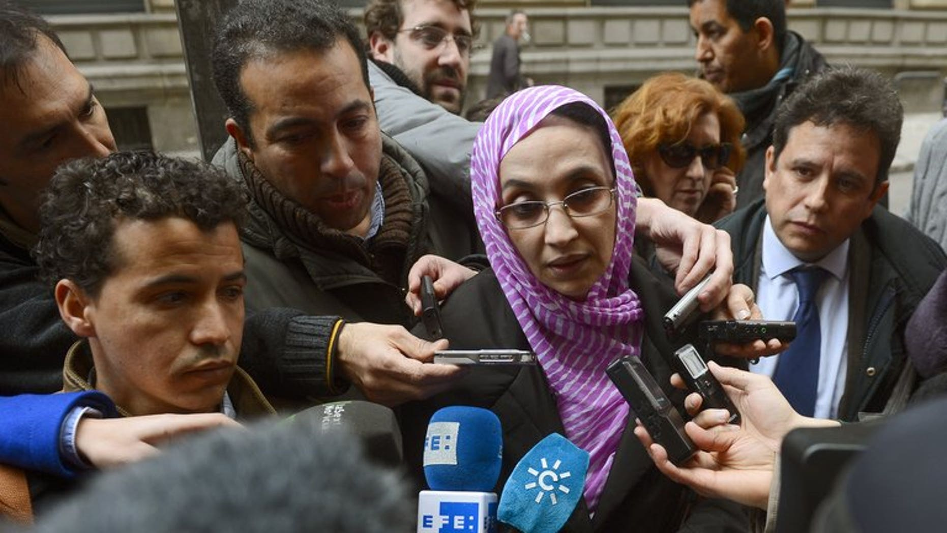 Sahrawi human rights activist Aminatou Haidar speaks to the media as she leaves the High Court in Madrid on March 13, 2013.