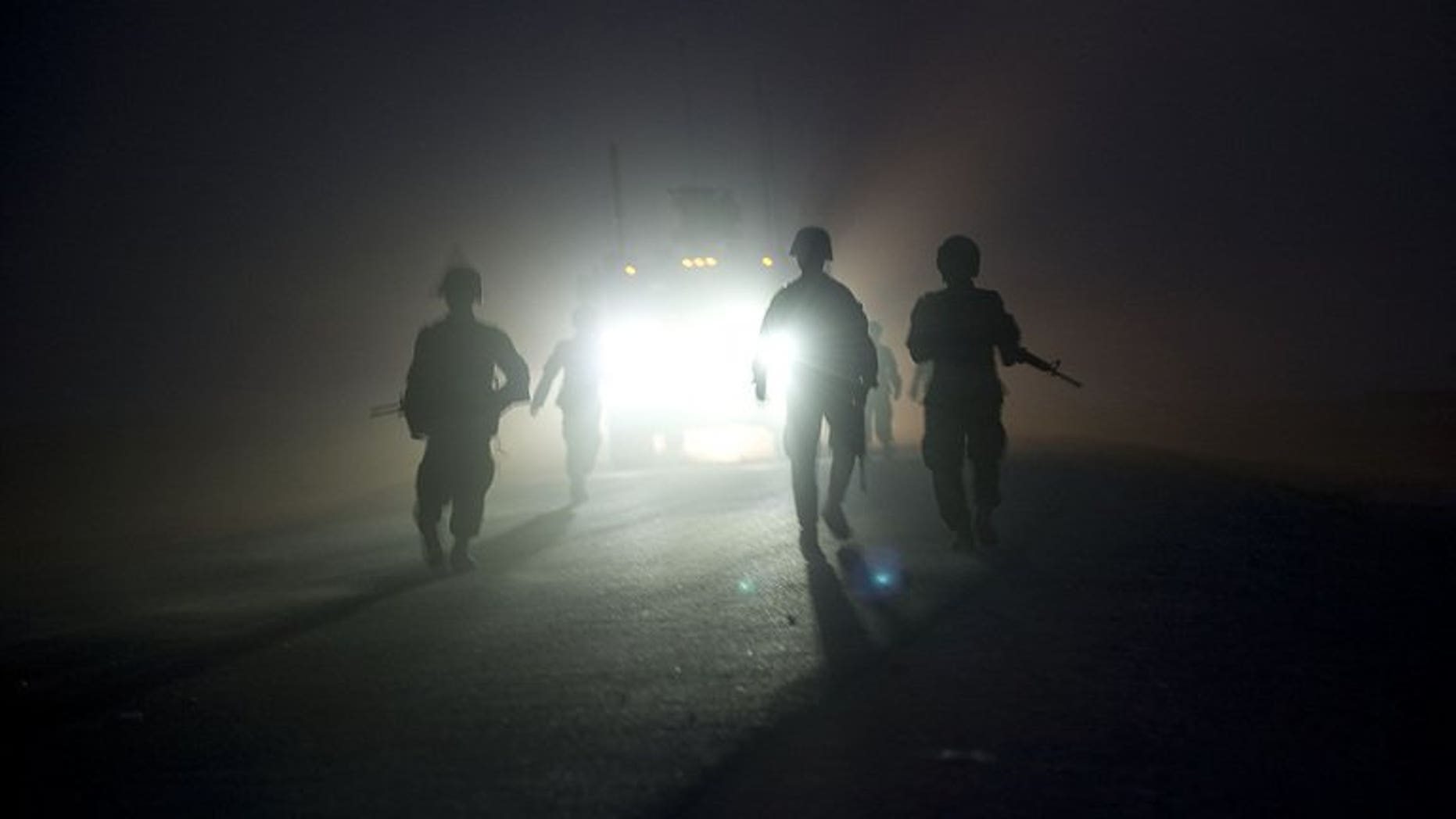 Soldiers operating under NATO command pictured during a patrol near the Morghan-Khecha village in Daman district, Afghanistan's Kandahar province, on September 8, 2012.