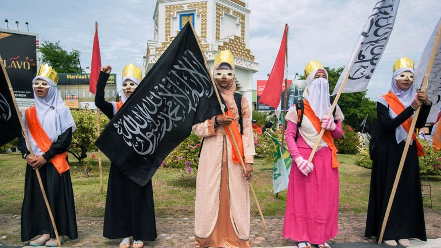 Muslim women stage a protest against the Miss World beauty pageant contest in Banda Aceh, northern Sumatra island, on September 14, 2013. The Miss World beauty contest, which has attracted fierce opposition by hardline Islamic groups in Indonesia, is now facing another challenge -- a rival pageant exclusively for Muslims.
