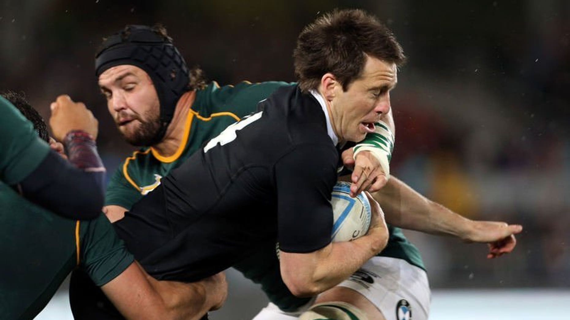 Ben Smith of New Zealand (right) is tackled by Flip van der Merwe of South Africa during their Rugby Championship Test in Auckland on September 14, 2013. New Zealand won 29-15.