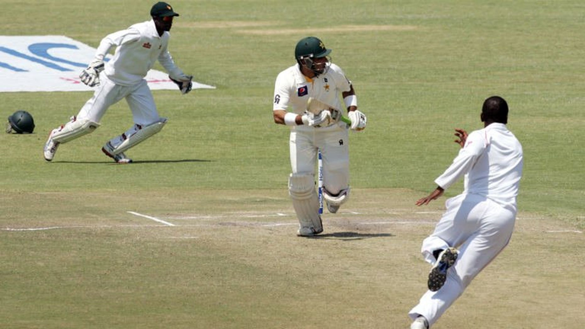 Pakistan's captain Misbah-Ul-Haq (centre) runs during the second Test match against Zimbabwe in Harare on September 14, 2013. Misbah hit his third half-century of the series, but his team lost three wickets on a tense fifth day of the second Test.