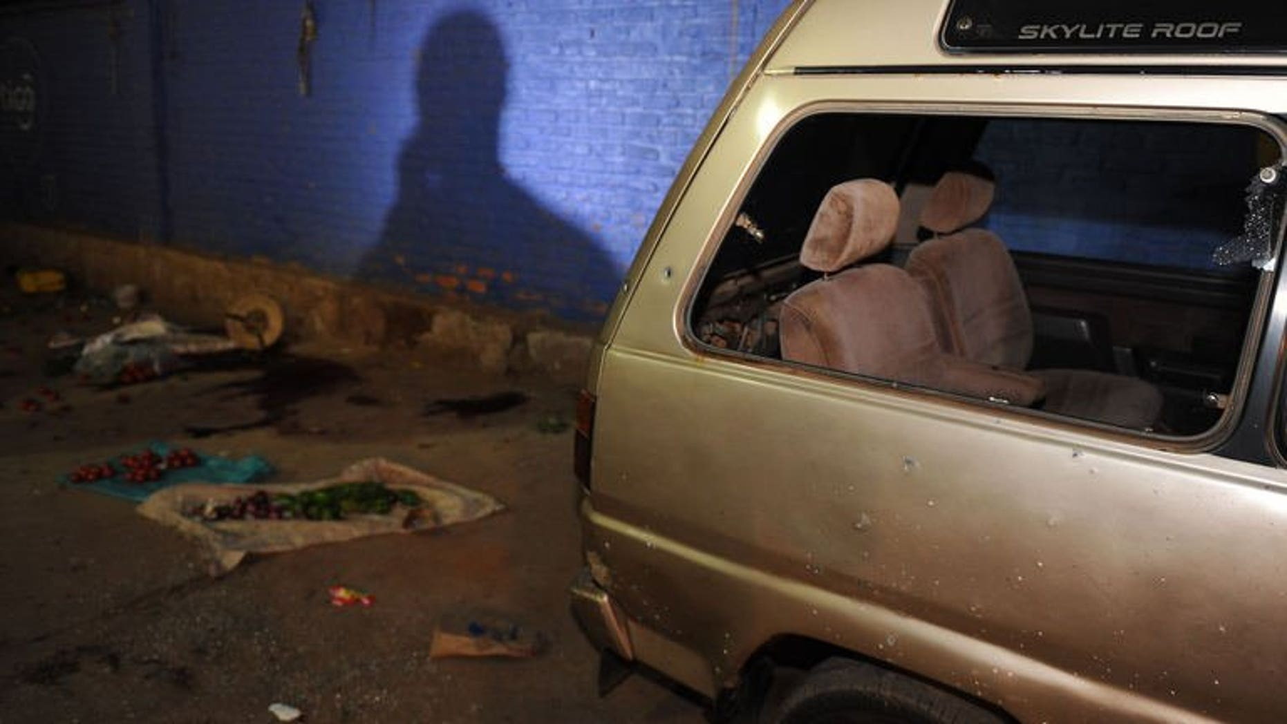 A damaged vehicle at the scene of a grenade attack in Kigali, Rwanda on September 13. One person was killed in the attack.