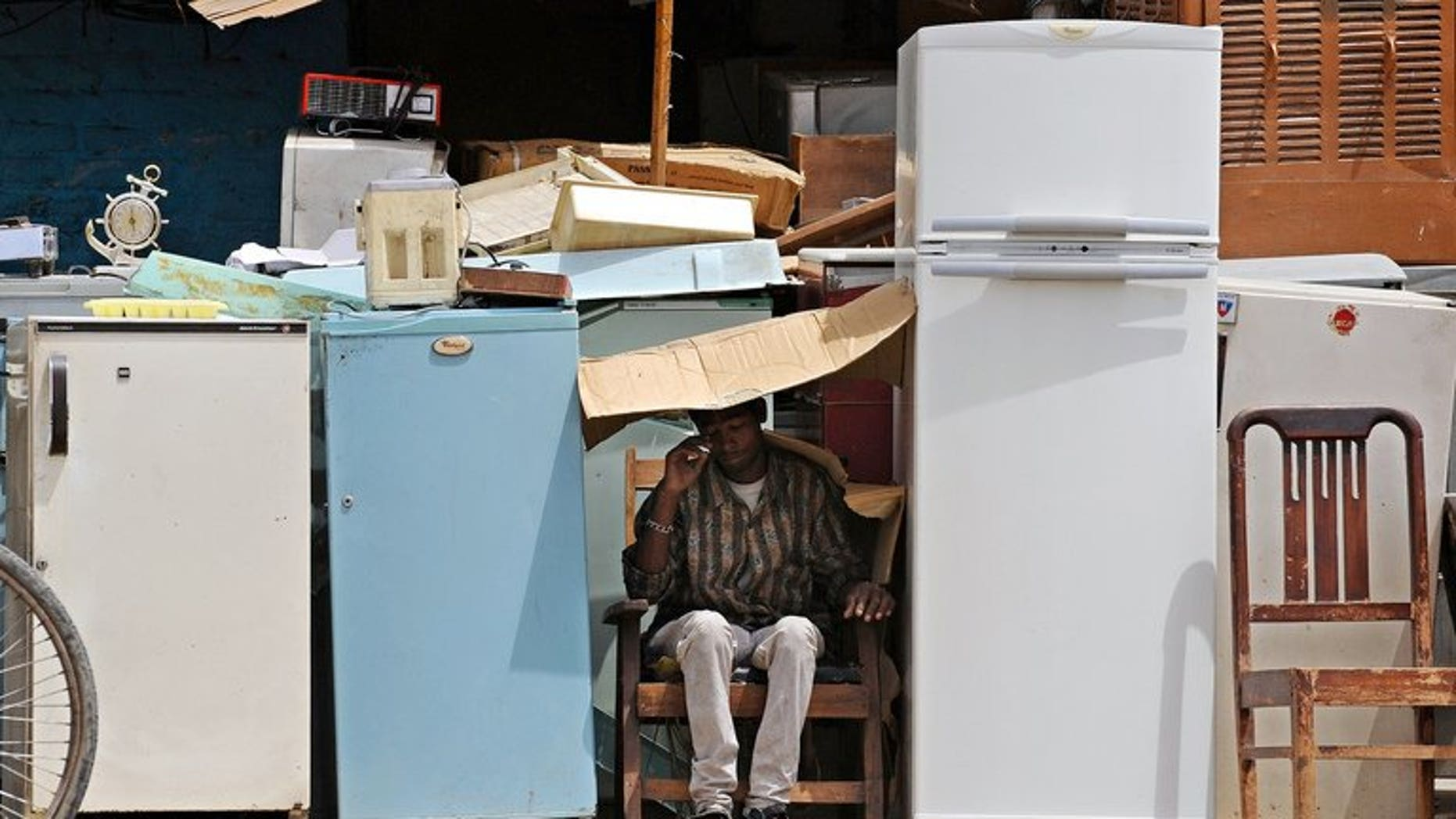 Used refrigerators are displayed for sale. Three South African children were found dead by a grandparent after becoming stuck in an abandoned refrigerator as they played near their home, police have said.