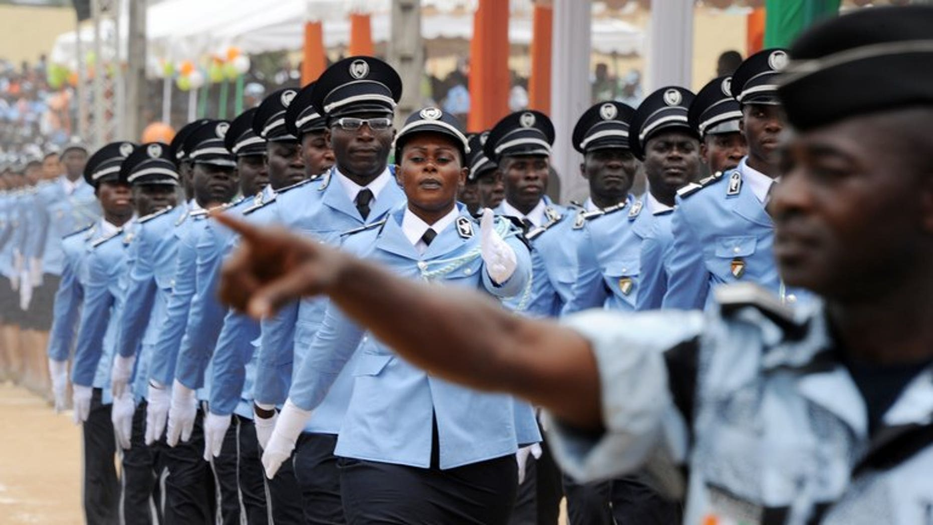 Ivorian police officers march during a graduation ceremony on September 28, 2012 in Abidjan. Three members of the Ivorian security forces have been killed in Yamoussoukro, the administrative capital of Ivory Coast, in two separate attacks by armed gangs, officials said.