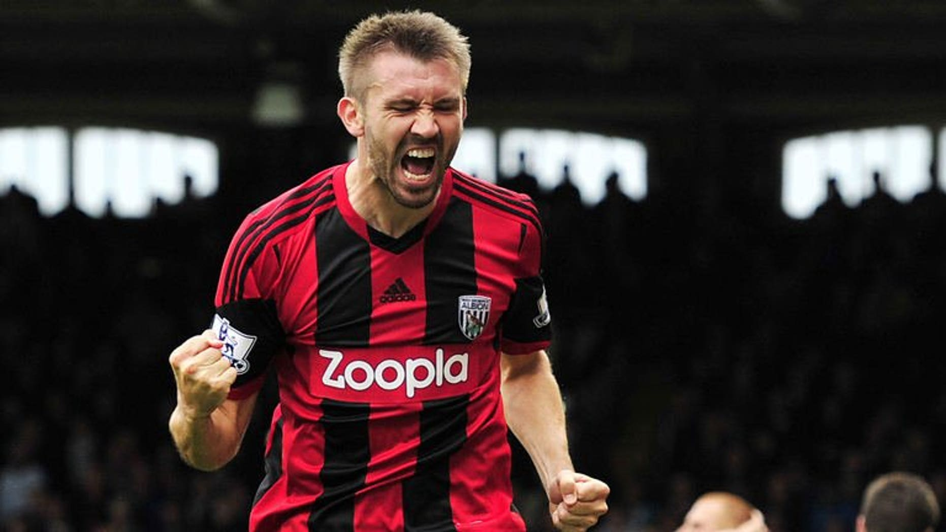 West Bromwich Albion's Northern Irish defender Gareth McAuley celebrates scoring the equalising goal during the English Premier League football match between Fulham and West Bromwich Albion at Craven Cottage in London on September 14, 2013. The match ended in a 1-1 draw.