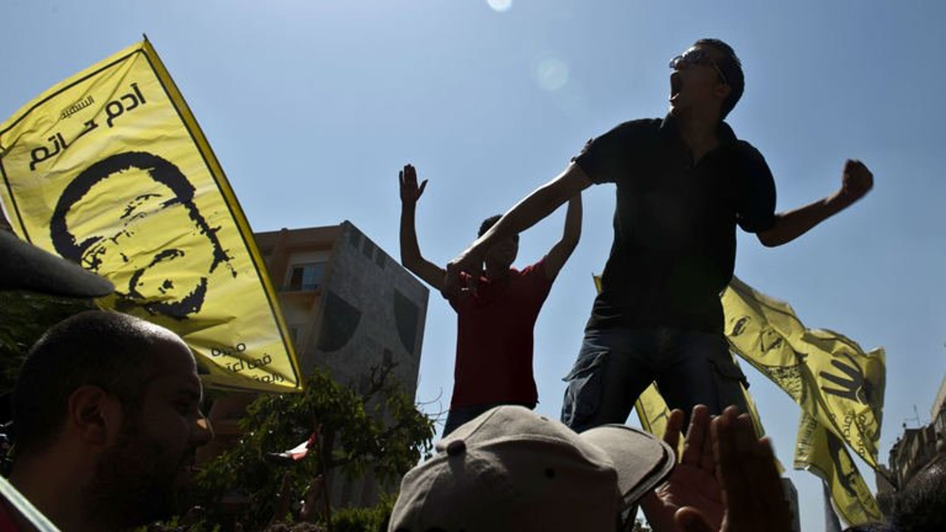 Supporters of ousted Egyptian president Mohamed Morsi shout slogans during a demonstration against the military backed government on September 13, 2013 in the Egyptian capital, Cairo.