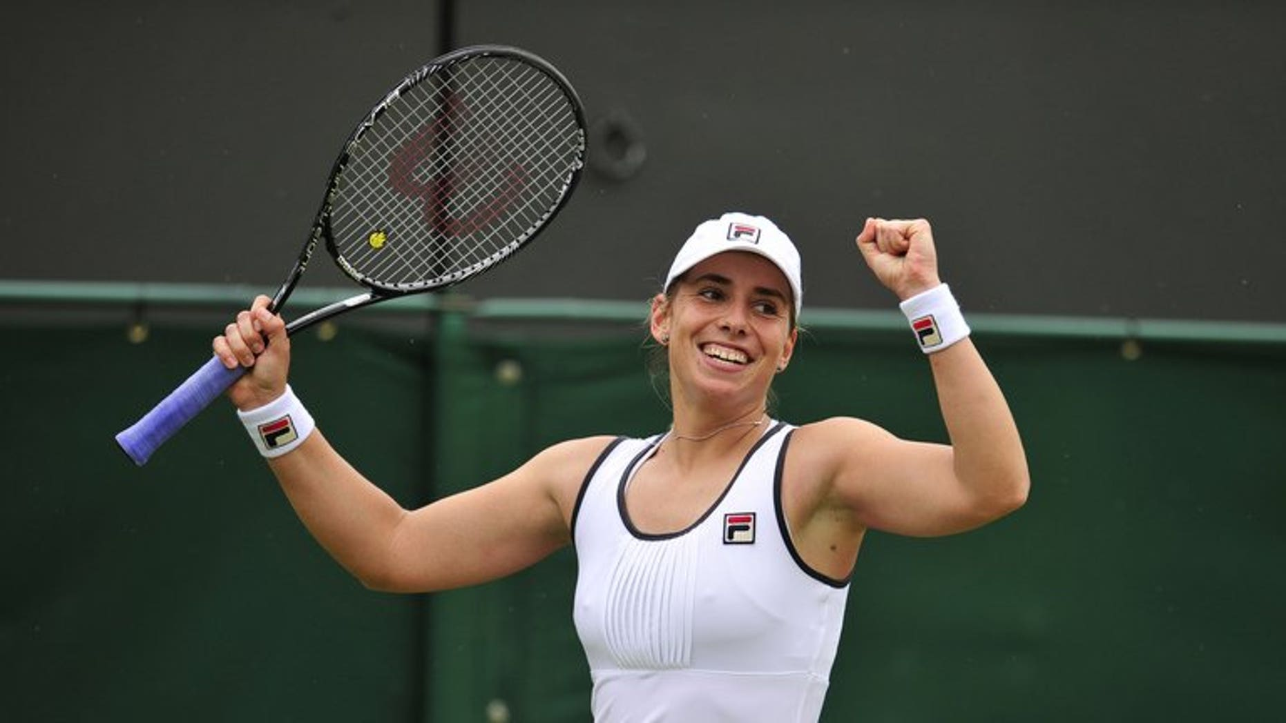 New Zealand's Marina Erakovic celebrates beating China's Peng Shuai during the 2013 Wimbledon Championships in Wimbledon, southwest London, on June 27, 2013.