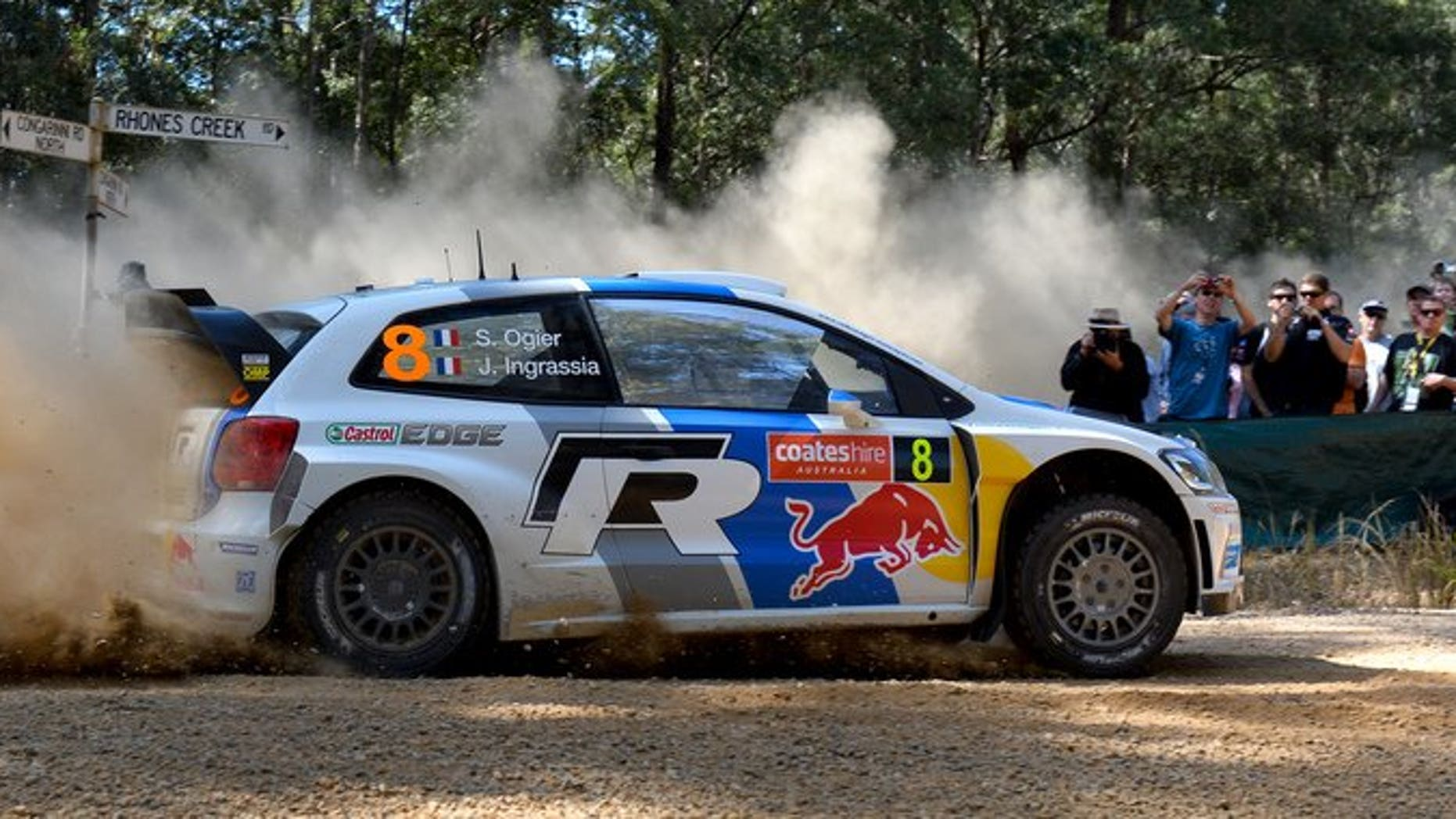 Volkswagen driver Sebastien Ogier of France slides his car through a corner in Rally Australia in the World Rally Championship (WRC) in Coffs Harbour on September 14, 2013.