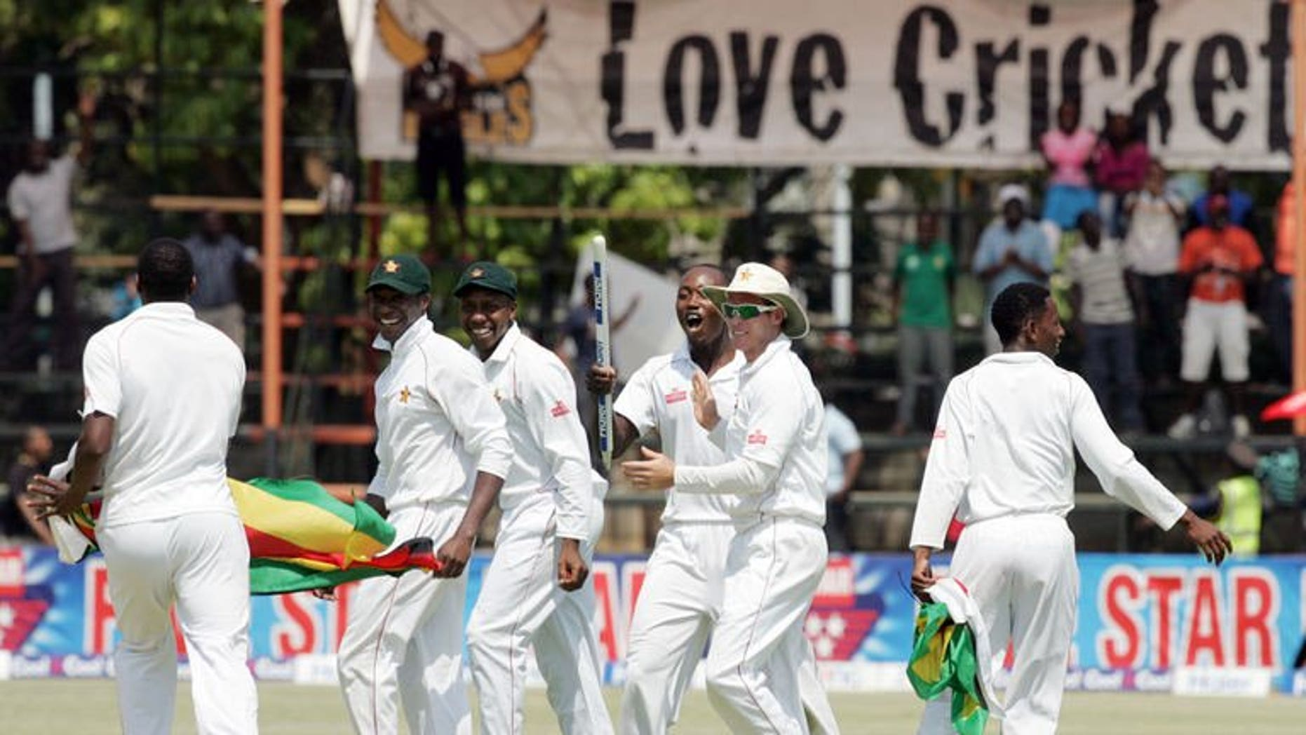 Zimbabwe players celebrate victory over Pakistan on September 14, 2013 during the fifth day of the second Test against at the Harare Sports Club. Former Pakistan cricket greats and fans have demanded a new national team captain and coach after an embarrassing defeat against minnows Zimbabwe.