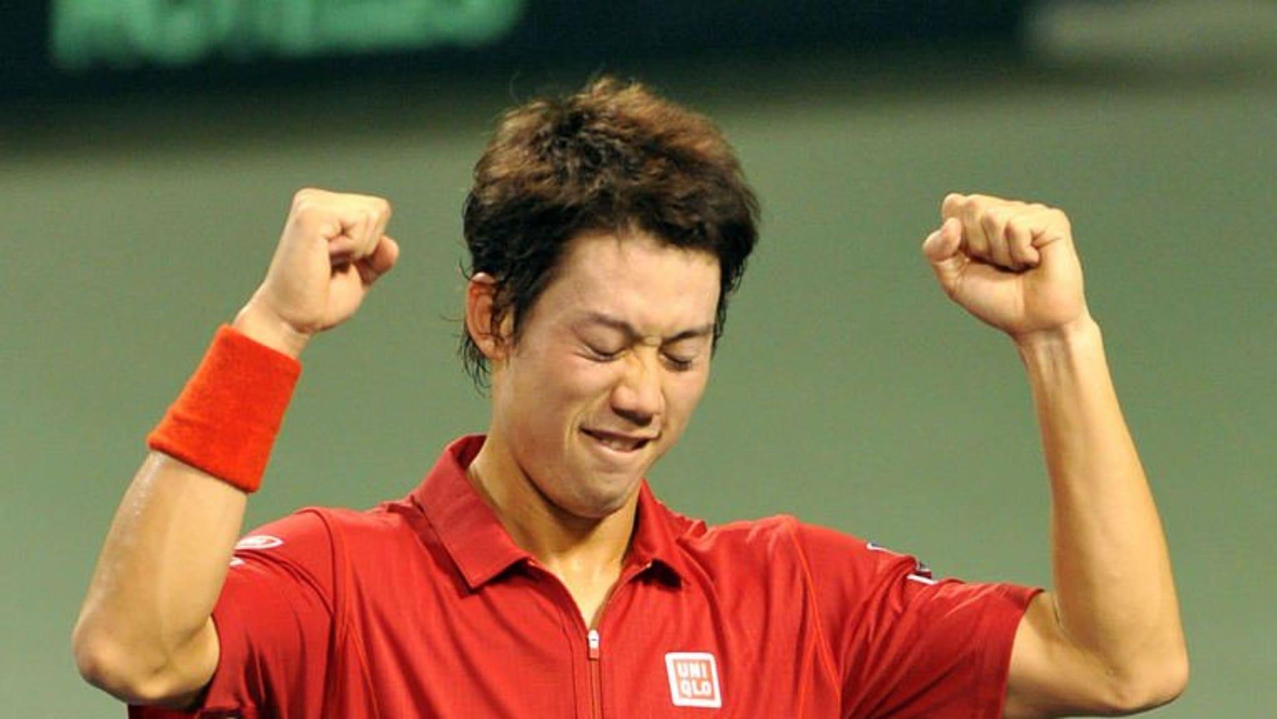 Japan's Kei Nishikori celebrates his win over Santiago Giraldo of Colombia after their Davis Cup World Group play-off in Tokyo on September 15, 2013. Nishikori beat Giraldo 6-1, 6-2, 6-4, propelling Japan back into the Davis Cup world group.