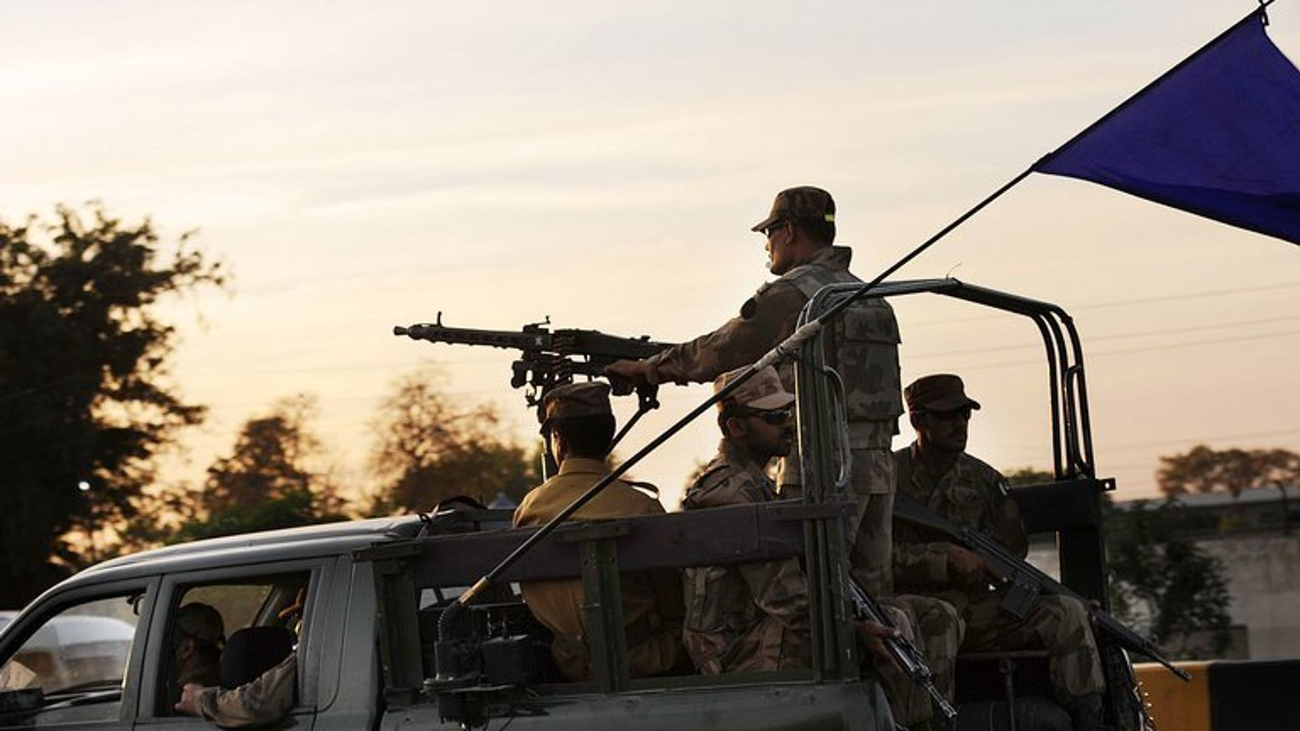 File picture shows troops deploying for the upcoming election in Nowshera, a district in the northwestern Pakistan province of Khyber Pakhtunkhwa, May 9, 2013. A roadside bomb attack on Sunday killed Pakistan's two senior military officers and a soldier in the country's troubled northwest, the military said.