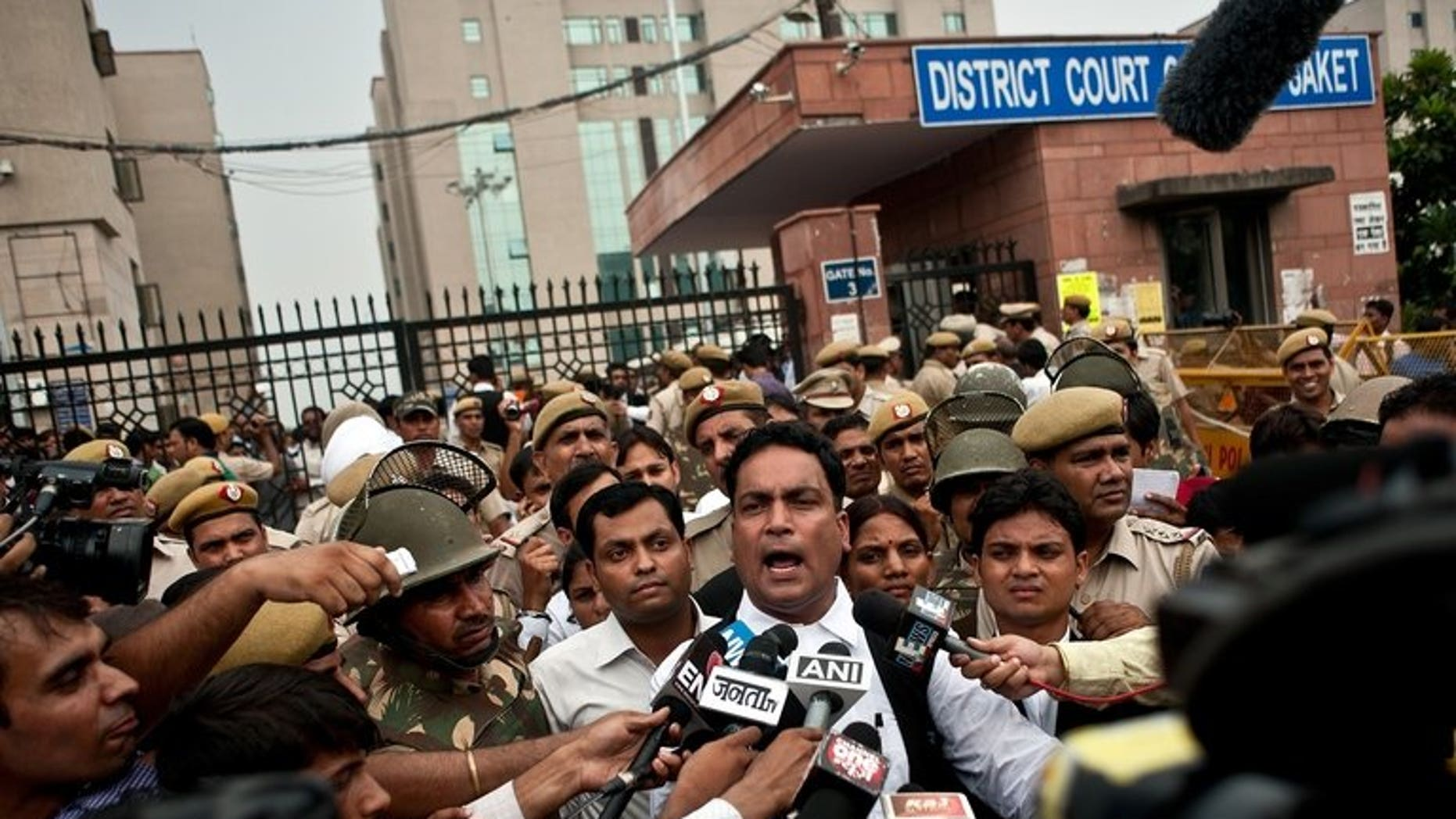 Indian defence lawyer A.P. Singh (C) addresses the media outside the Saket Court complex following the sentencing of four men convicted of rape and murder in New Delhi on September 13, 2013.