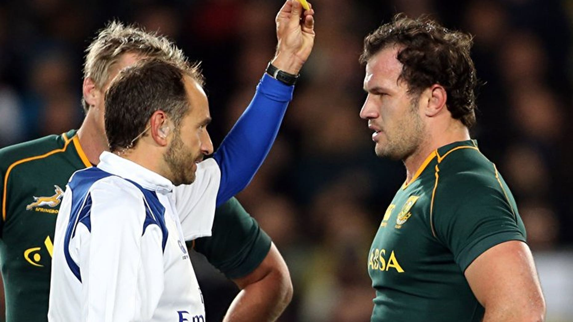 Bismarck du Plessis of South Africa (R) is yellow-carded by referee Romain Poite (L) during the Rugby Championship Test rugby union match between the New Zealand All Blacks and South Africa at Eden Park in Auckland on September 14, 2013.