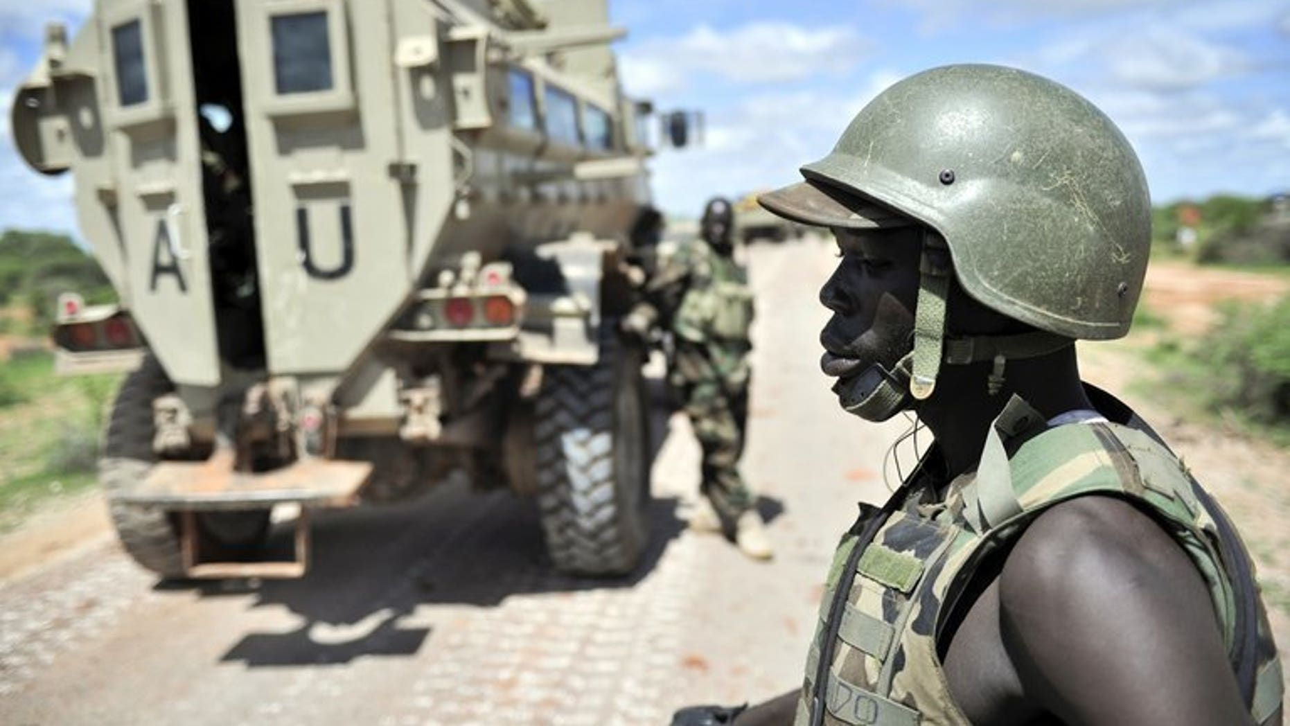 Ugandan soldiers, part of the African Union Mission in Somalia (AMISOM), patrol along the Afgooye-Baidoa road in Somalia on October 19, 2012. Uganda said it had suspended 24 of its army officers, who were part of a UN-mandated force battling Al-Qaeda linked rebels in Somalia, over corruption allegations.