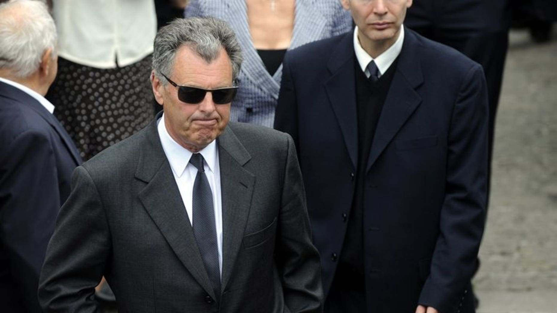 Scottish golfer Bernard Gallacher (C) attends the funeral of Spanish golf legend Severiano Ballesteros in Pedrena, Spain on May 11, 2011.