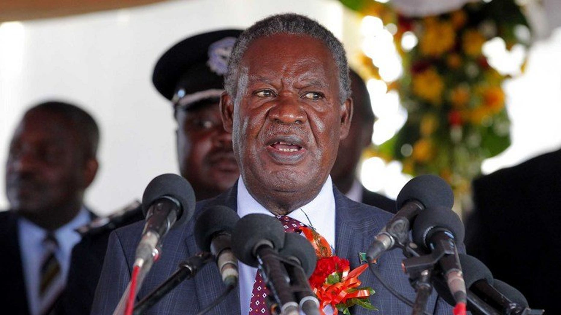 Zambian President Michael Sata speaks in Victoria Falls on May 29, 2012. Sata threatened to dissolve parliament and prompt fresh elections, accusing ministers of failing to defend his government from opposition attacks.